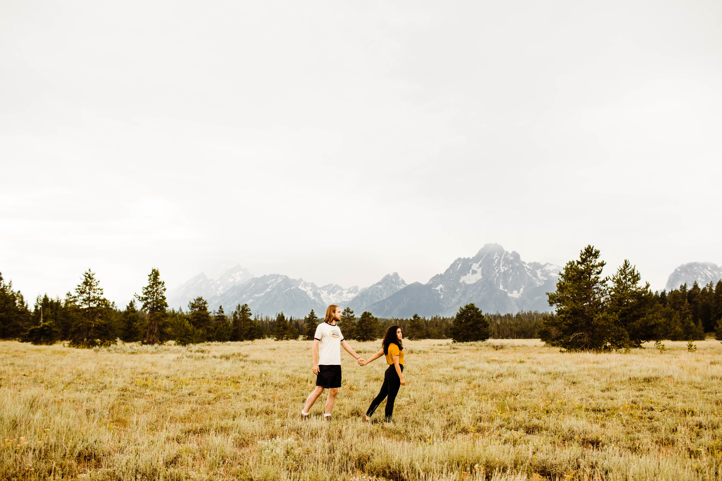 Copy of Engagement photos while walking through the Tetons | Best adventure wedding photographers