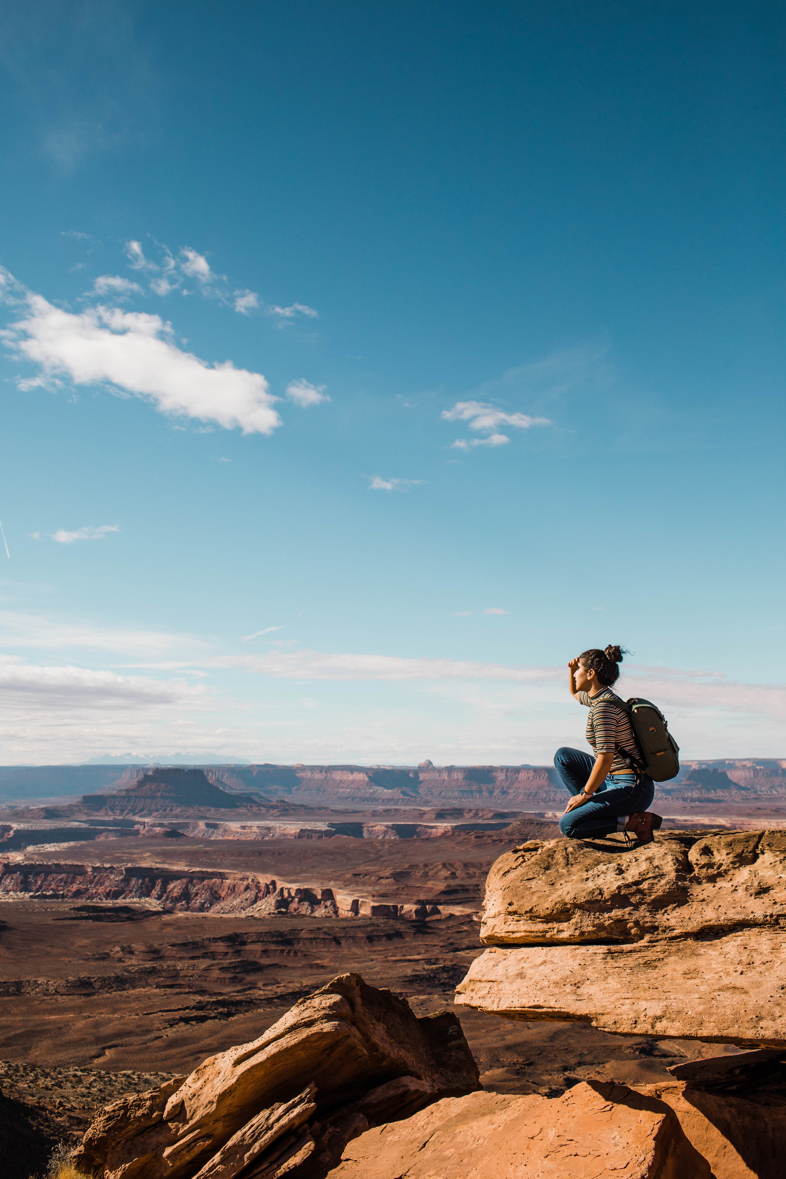 Standing on the edge of a canyon | Moab Elopement Photographer