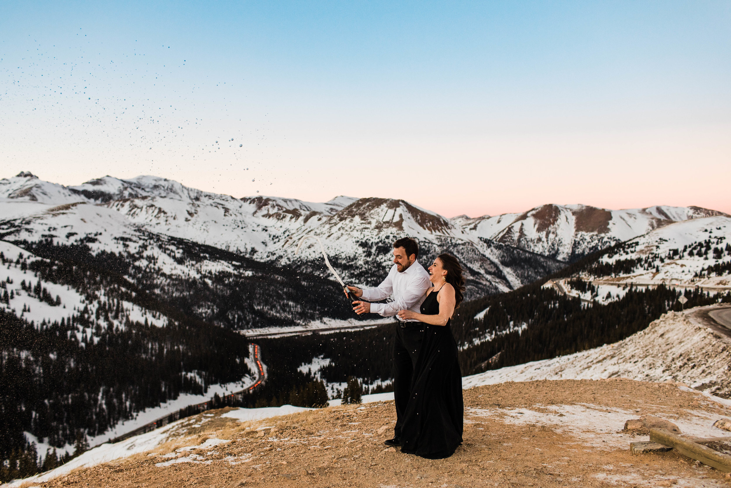 Popping champagne on top of a mountain | Colorado Elopement Photographer