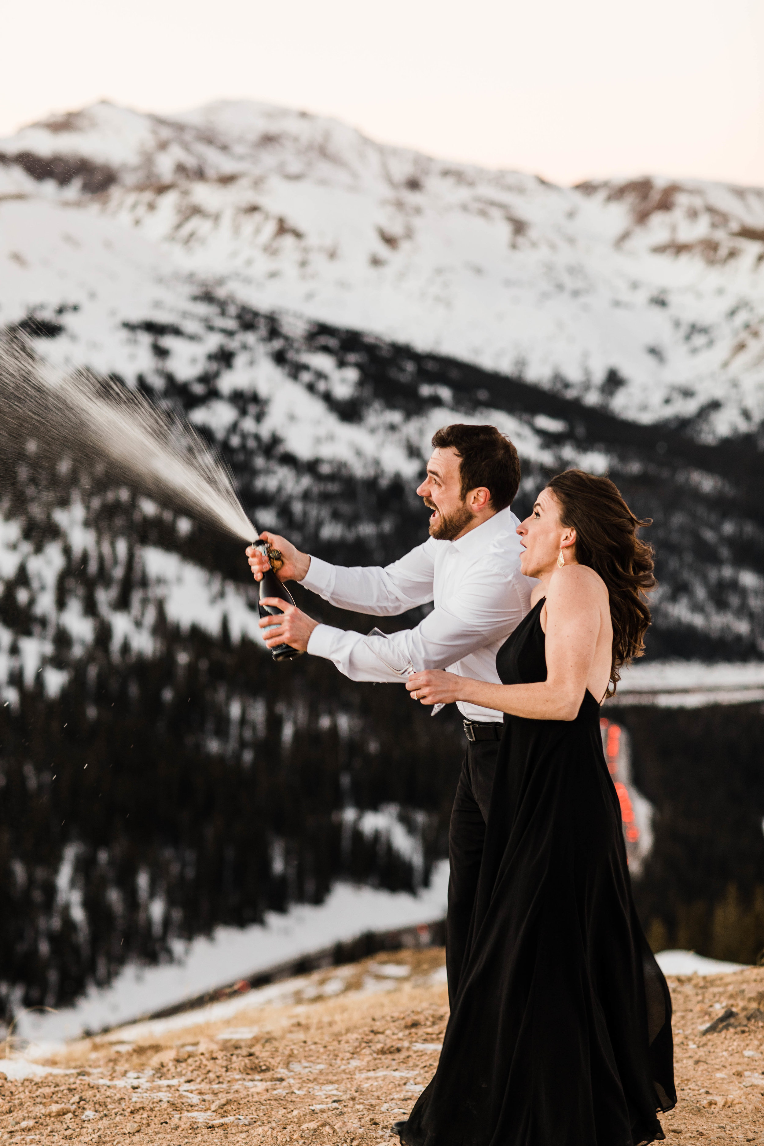 Popping champagne in the Rocky Mountains | Colorado Elopement Photography