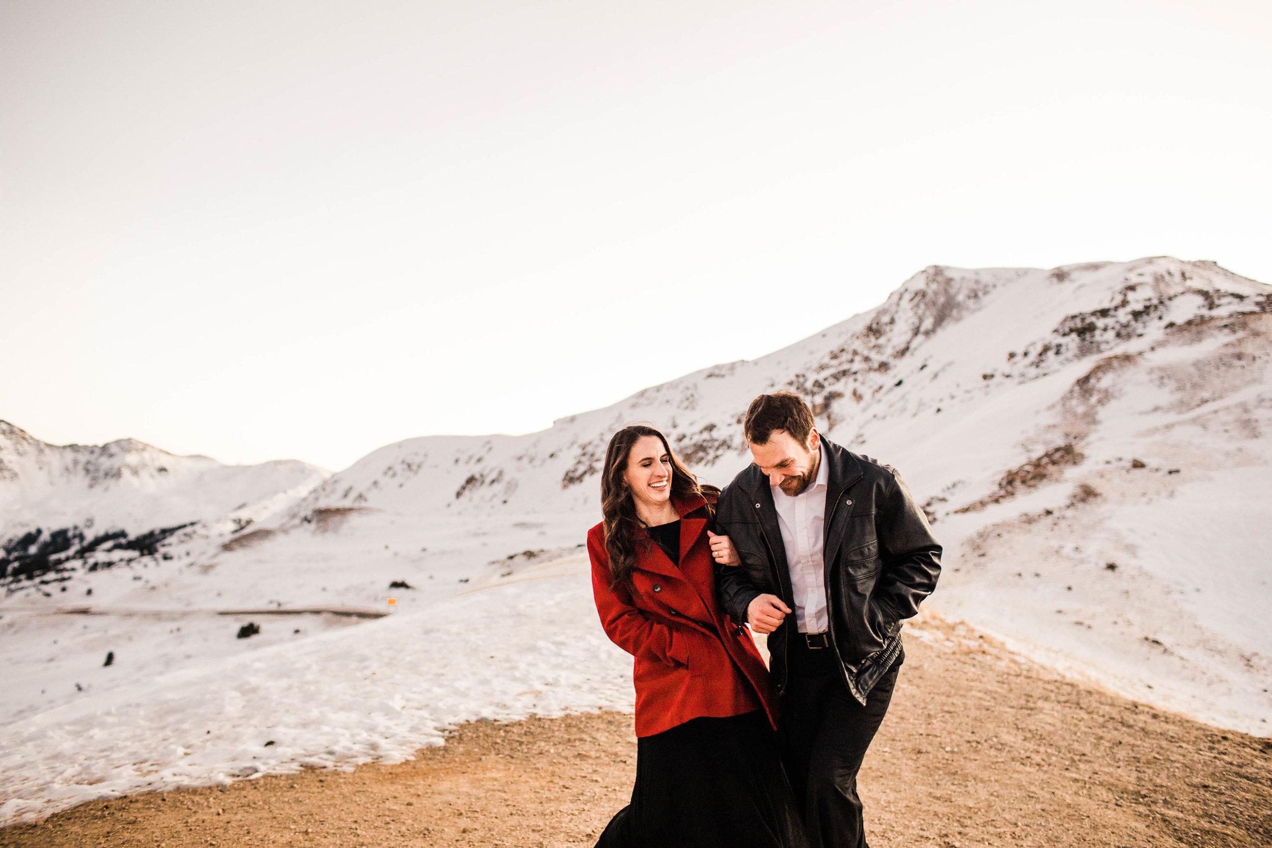 Running in the Rocky Mountain snow   Top Colorado adventure wedding photographer