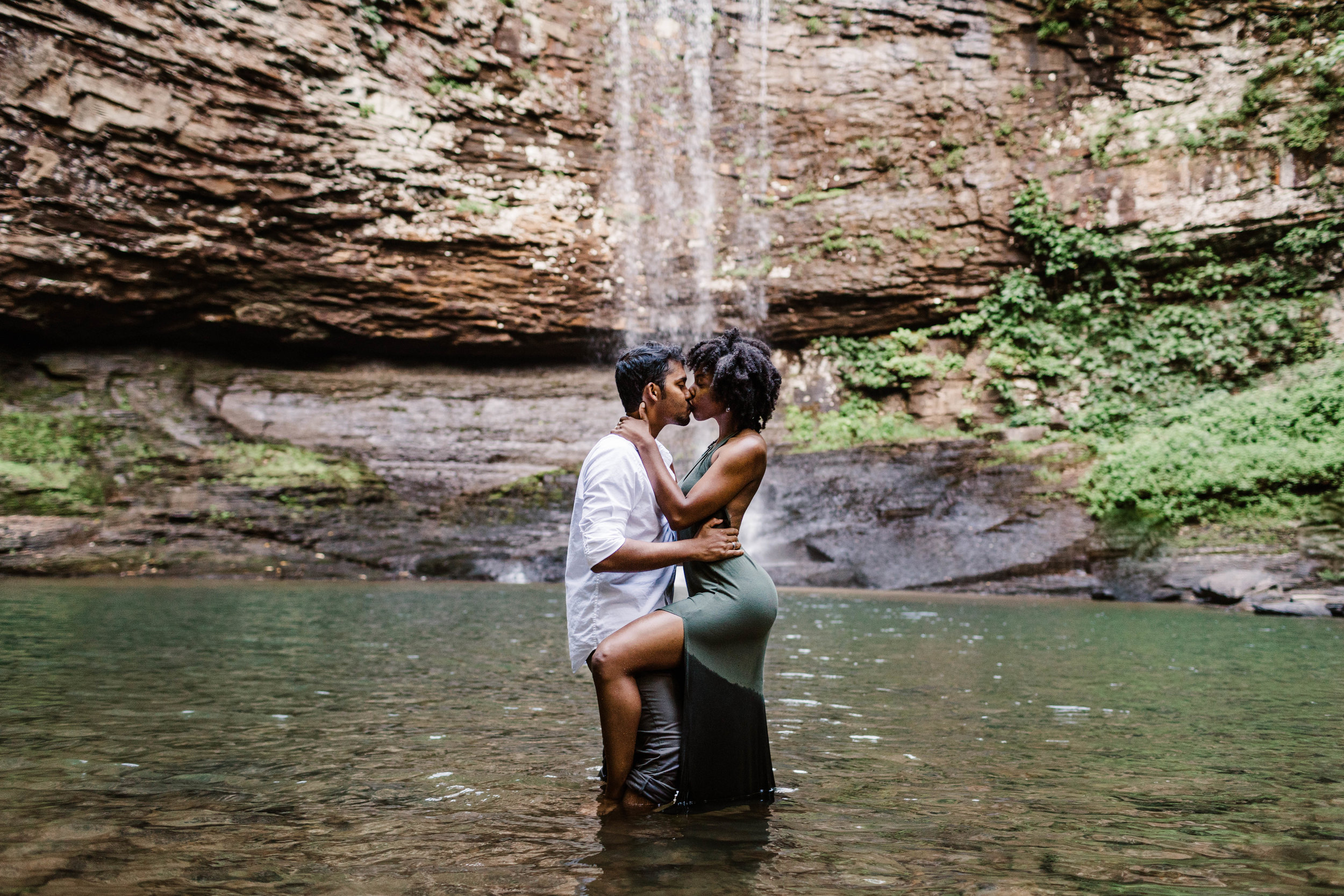 Kissing under waterfall in the mountains | Best Asheville Elopement Photographer 1