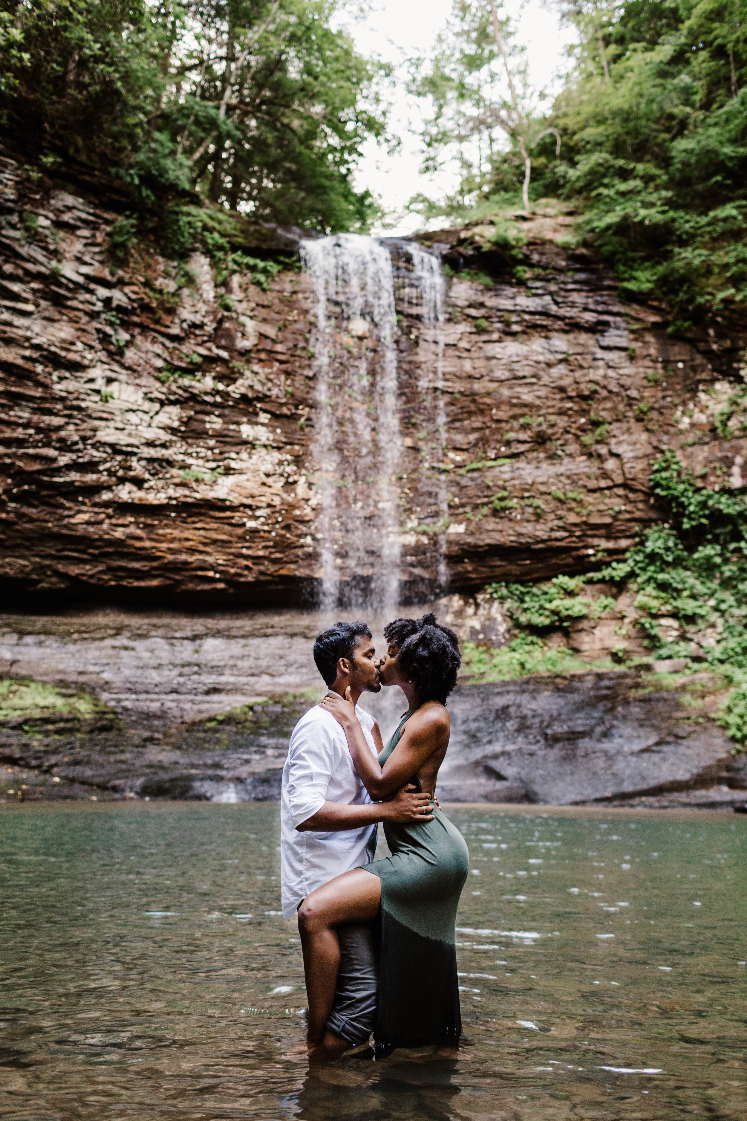 Kissing under waterfall in the mountains | Best Asheville Elopement Photographer 2