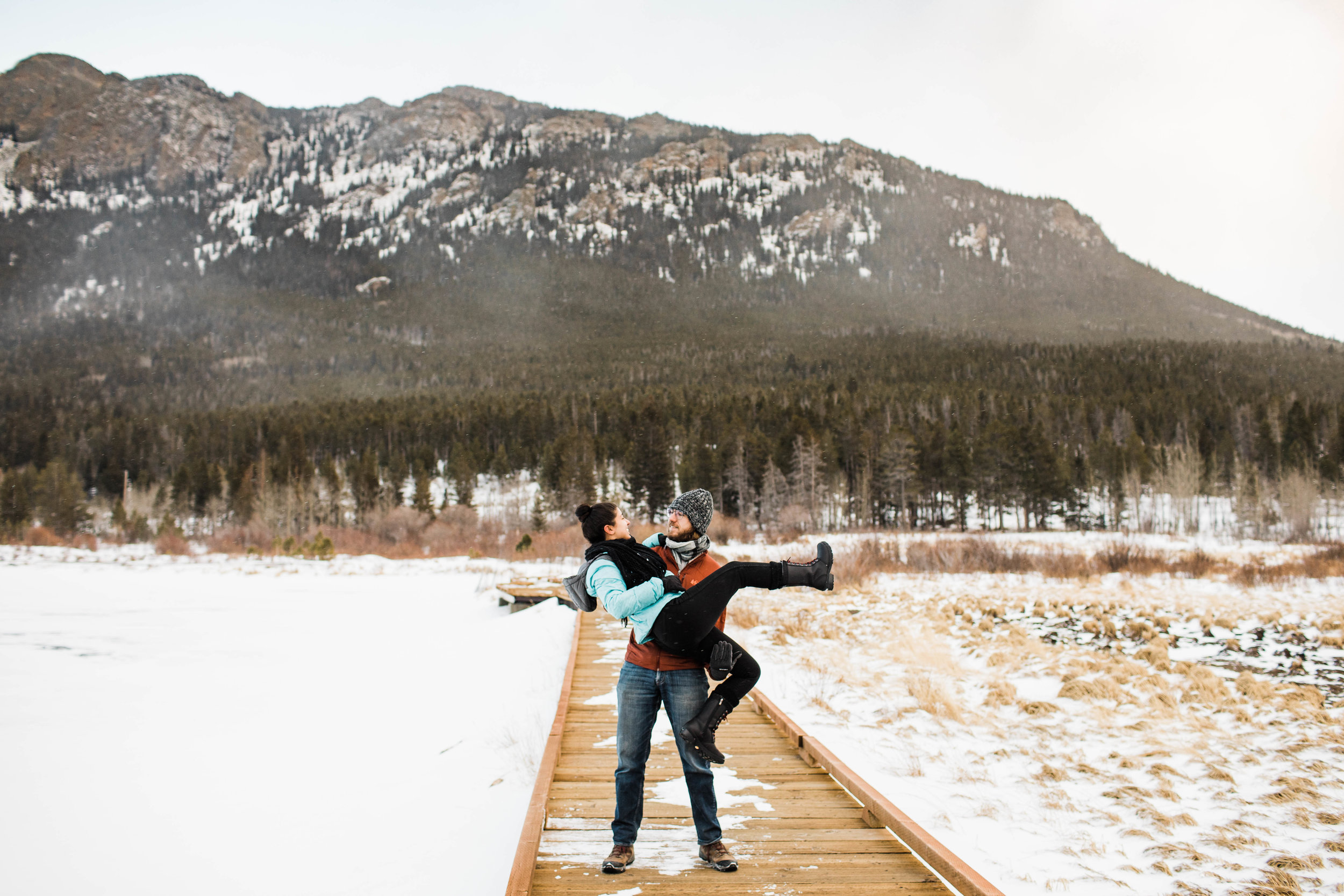Frozen lake adventure session in the Rocky Mountains | Best Colorado Wedding Photographers
