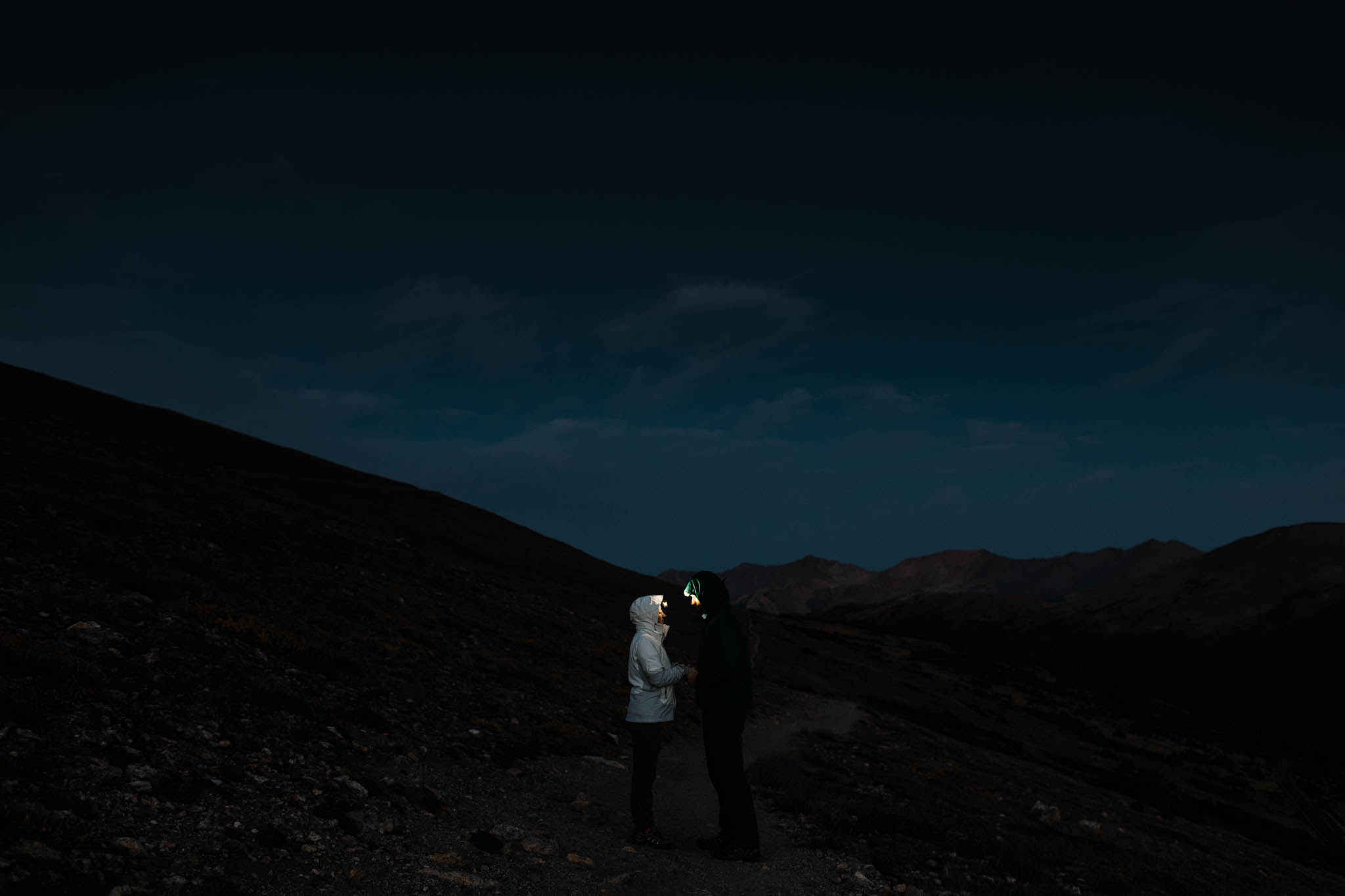 Hiking with headlamps on an post-wedding adventure session in the mountains | Best Colorado Wedding Photographers