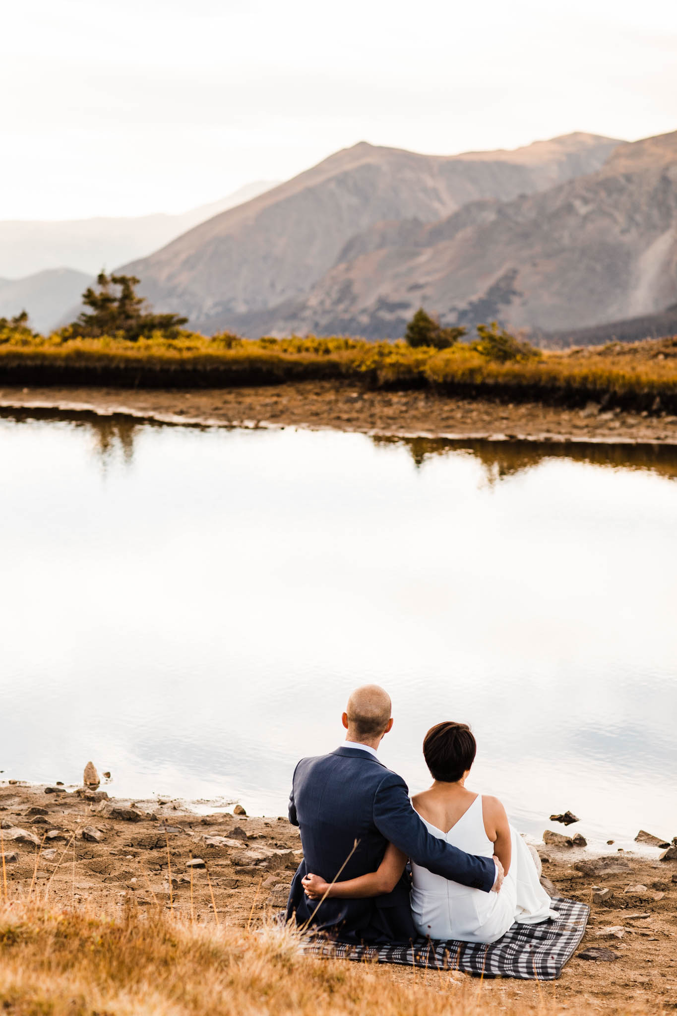 snuggling by a mountain lake | Rocky Mountain post-wedding session | Best Colorado elopement photographers