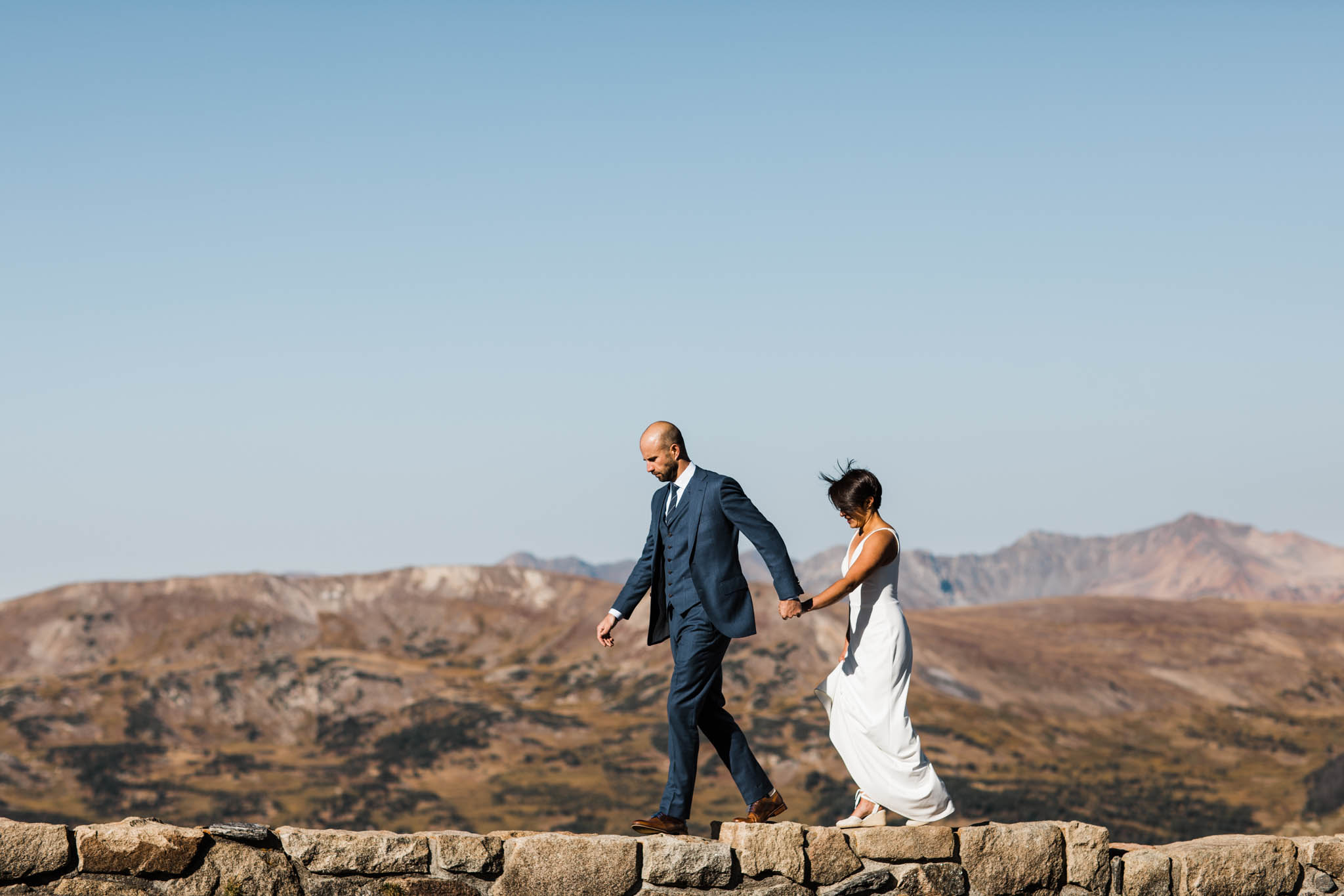 standing on the edge of the Rocky Mountains | Colorado elopement photographers | Best Colorado wedding photographers