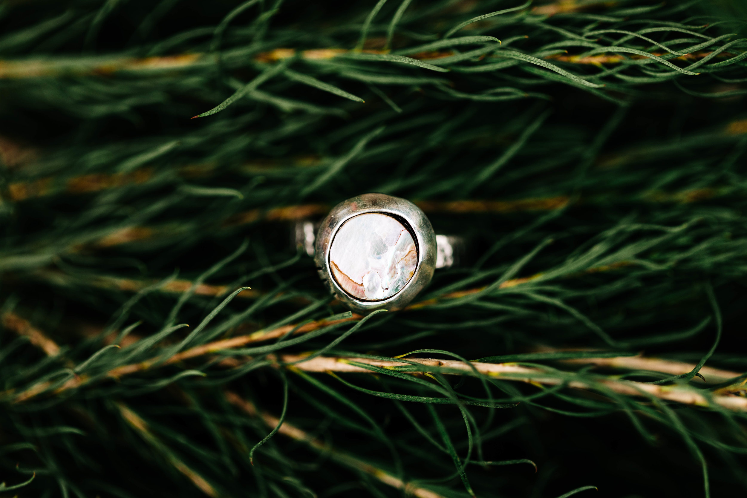 Handmade engagement ring with cloudy stone | Camper Van Elopement in Colorado | Colorado mountain wedding photographers