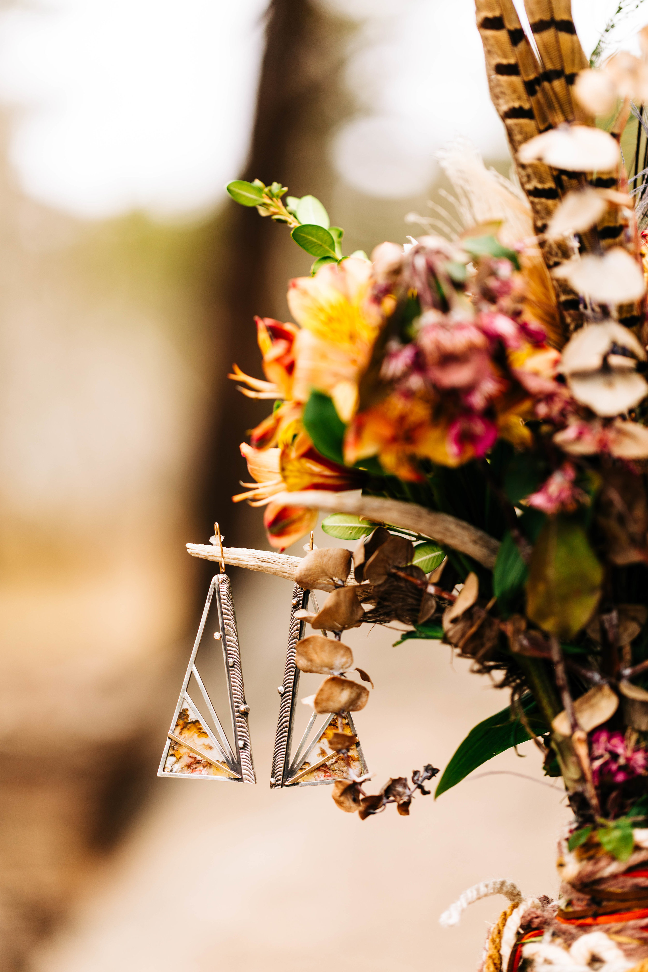Handmade silver boho earrings for an adventure elopement in the Rocky Mountains of Colorado | adventure wedding photographers