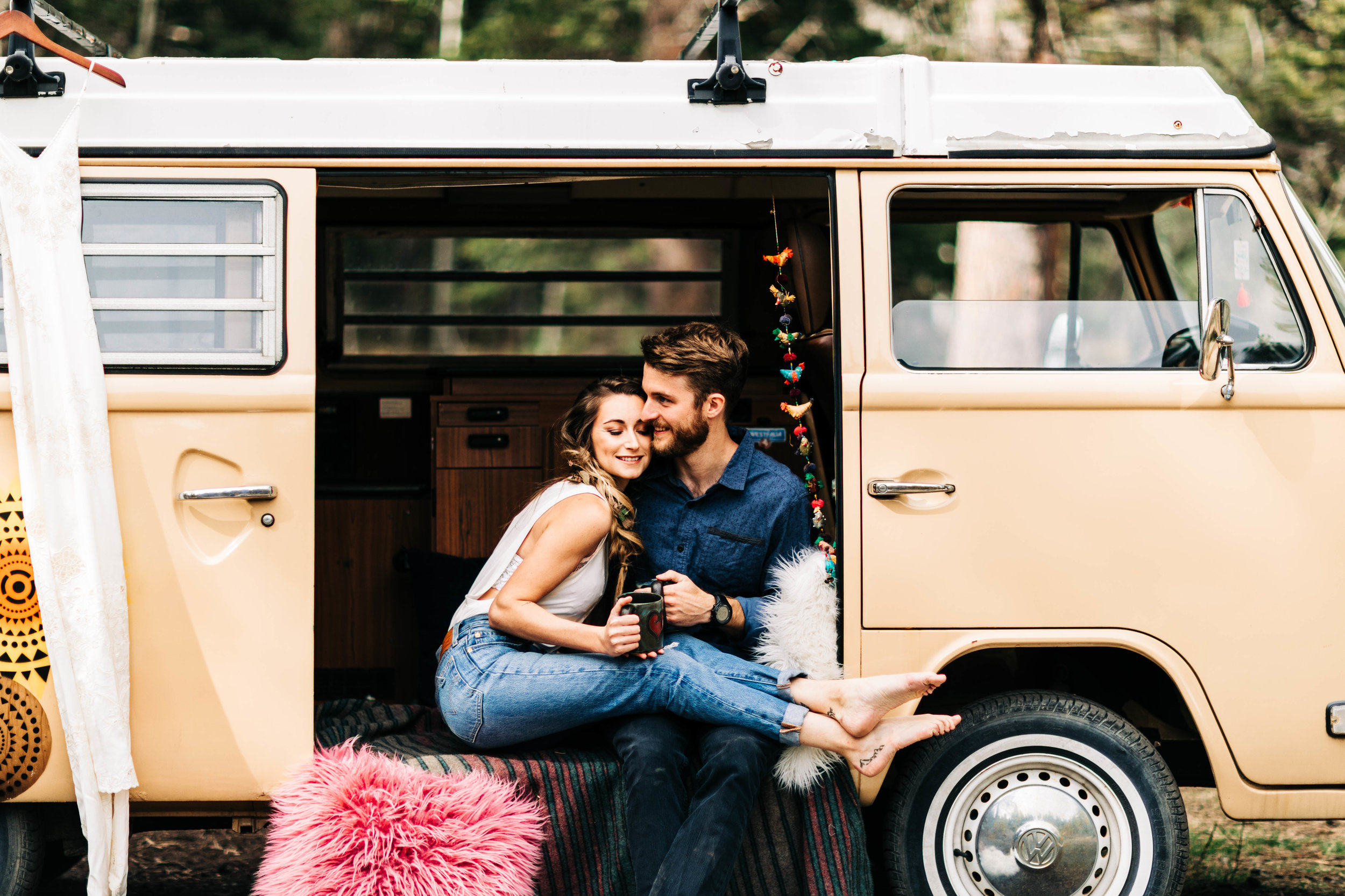 Colorado couple snugging in their camper van before their adventure elopement | Rocky Mountain elopement photographers