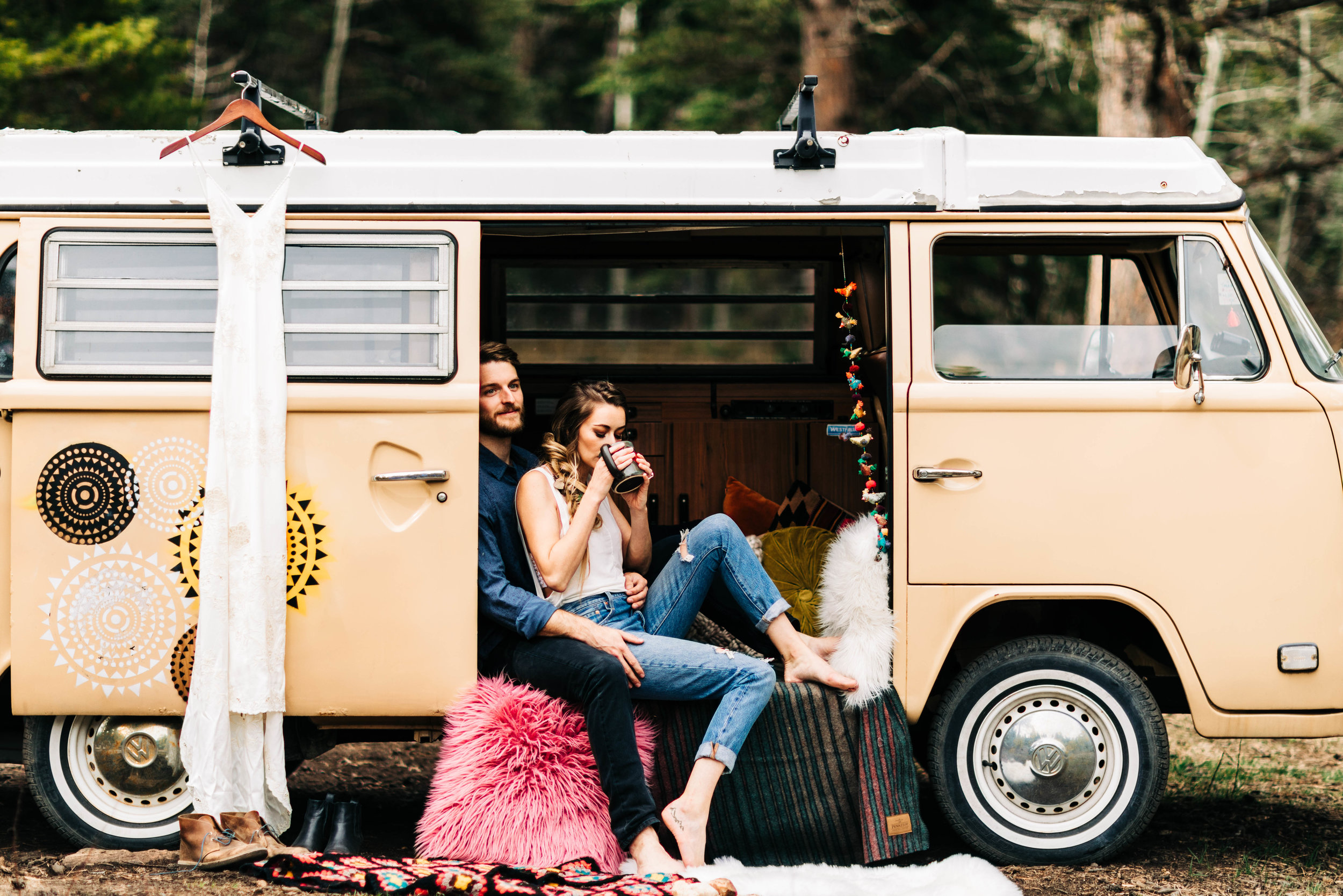 Colorado couple hanging out in their camper van before their mountain elopement | Colorado elopement photographers in the Rockies