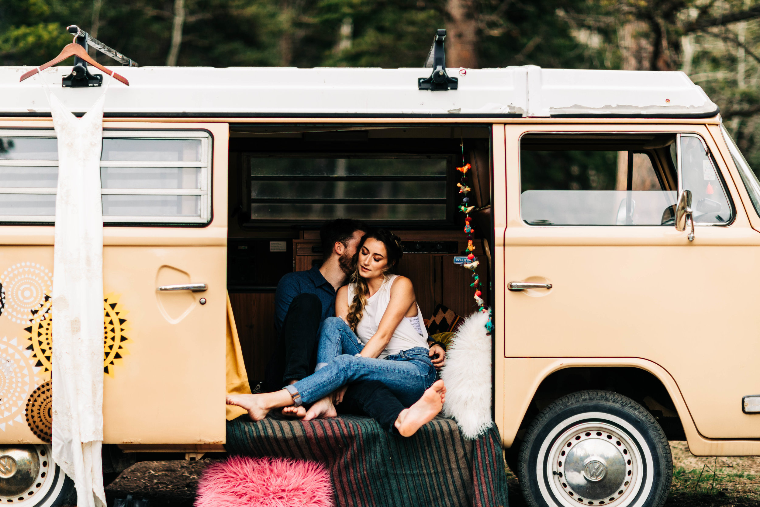 cute Colorado couple relaxing in their camper van before their Rocky Mountain elopement in the foothills of Colorado