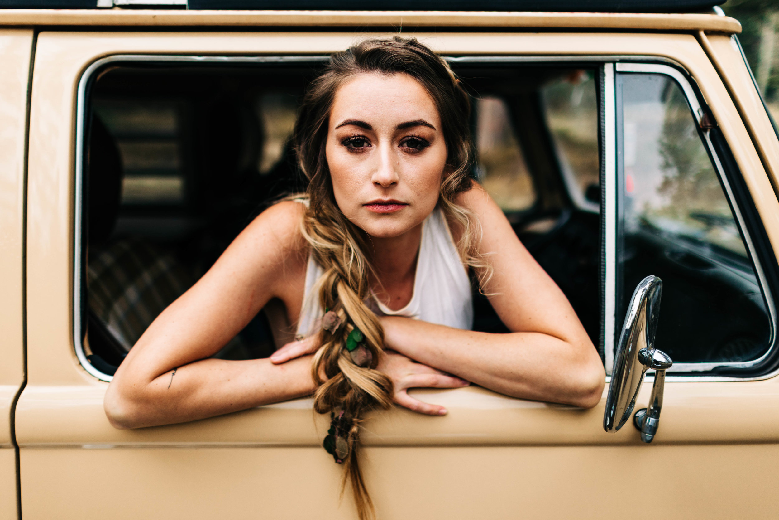 long chunky braid for a Colorado adventure elopement in a camper van | top Rocky Mountain wedding photographers
