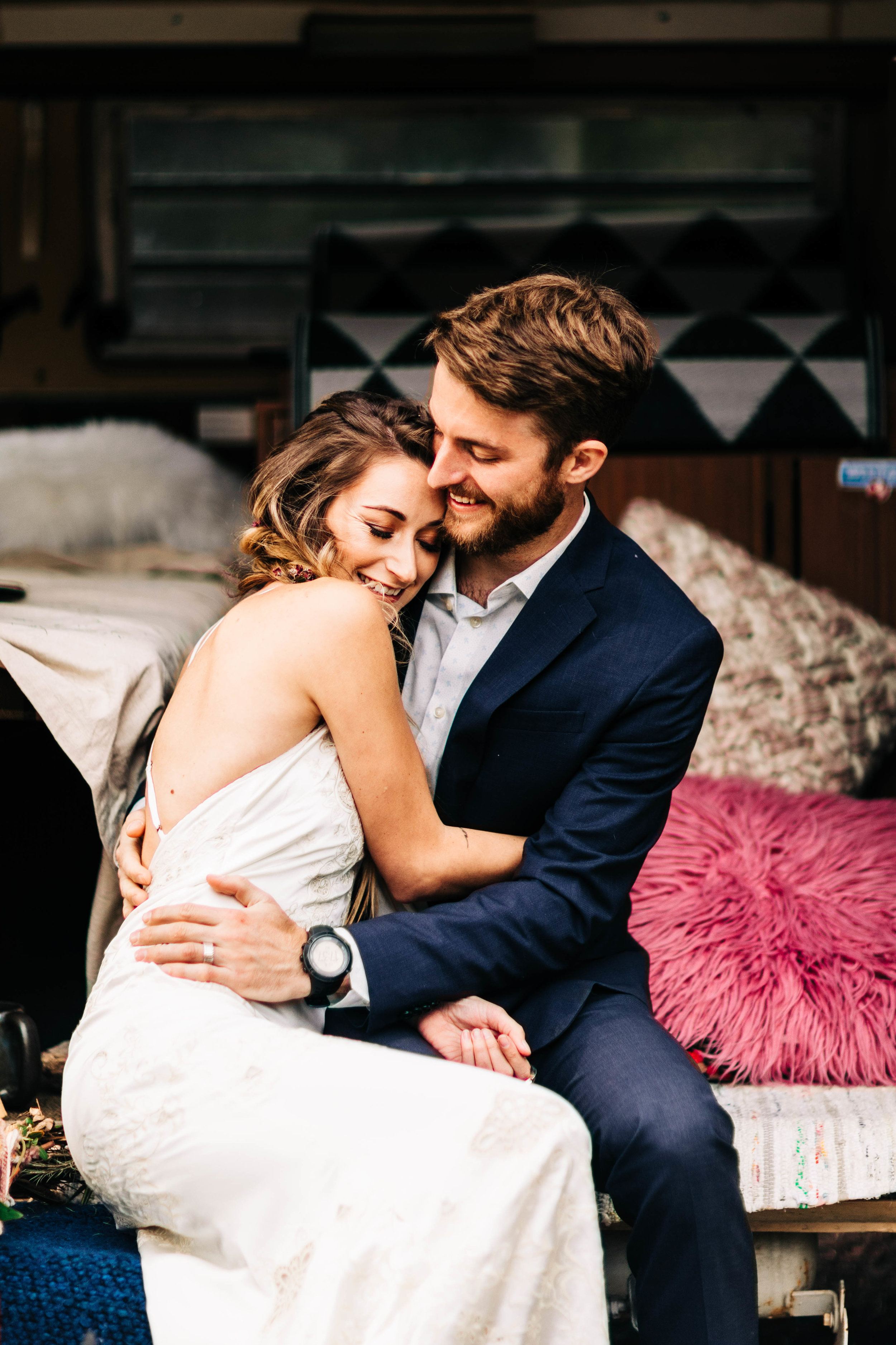 Colorado couple hugging before their camper van adventure elopement | Rocky Mountain elopement photographers