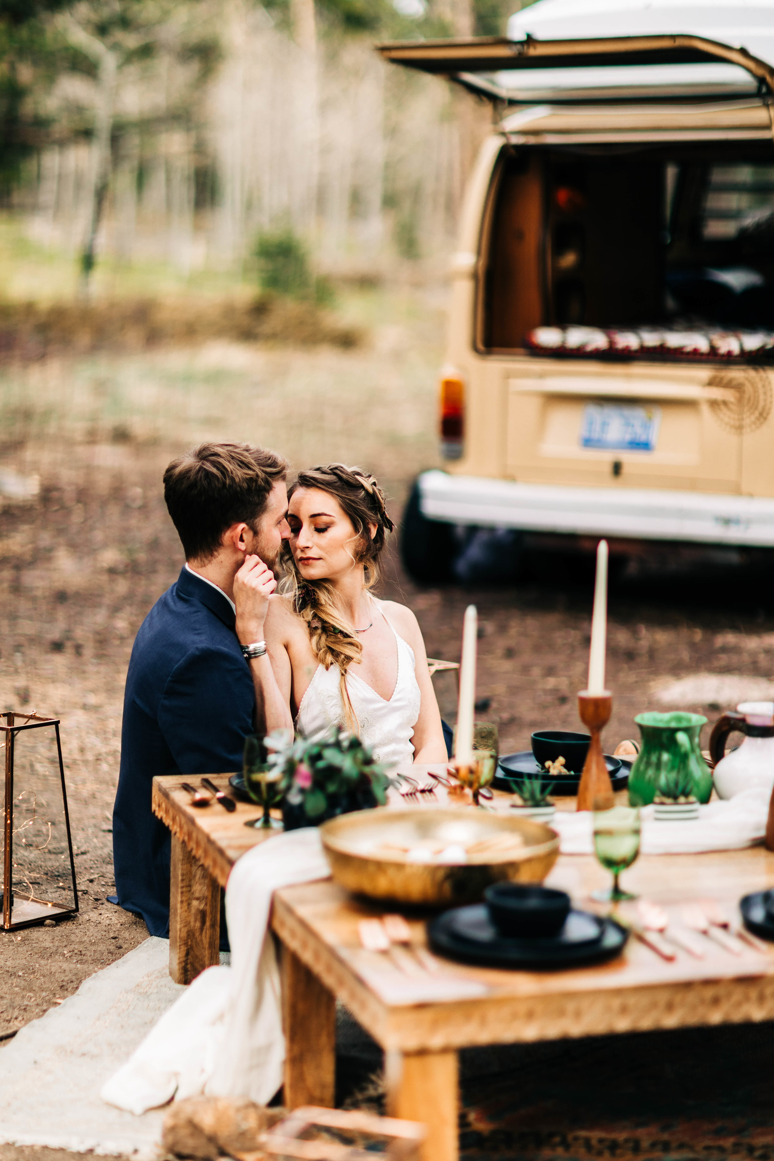 couple eating dinner after their camper van elopement in the Rocky Mountains | best Colorado elopement photographers