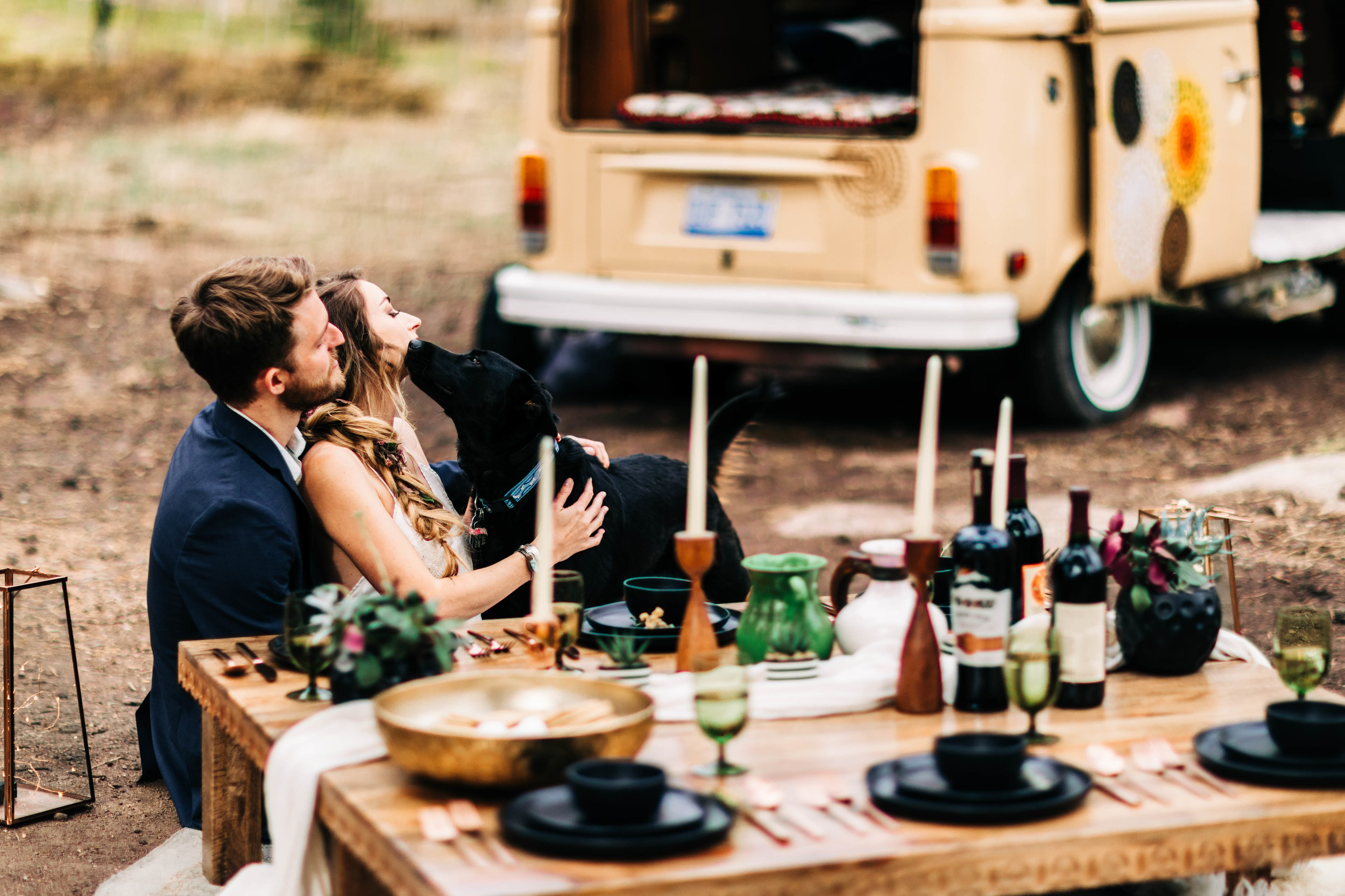 couple eating dinner after their camper van elopement in the Rocky Mountains | best adventure elopement photographers