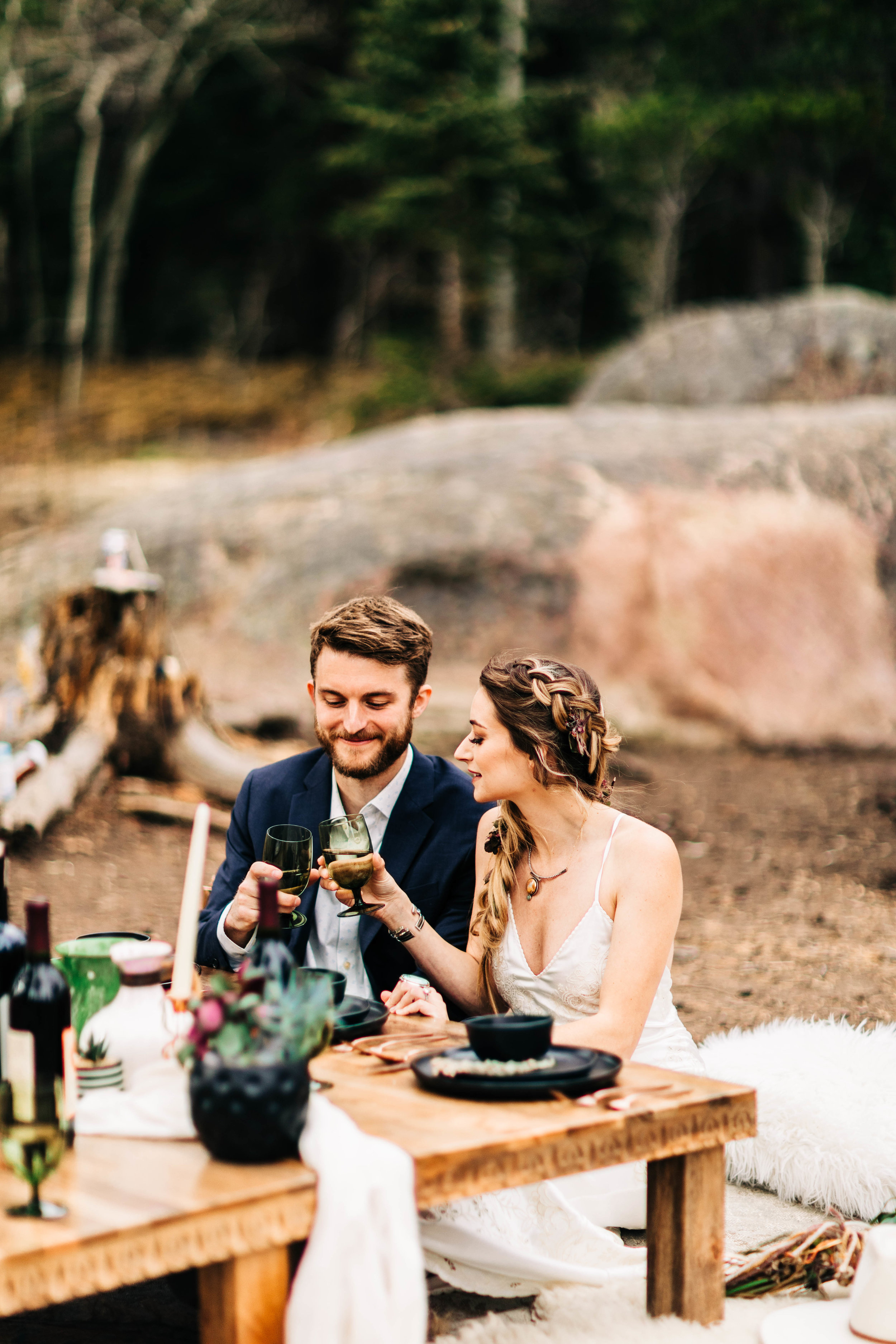couple eating dinner after their camper van elopement in the Rocky Mountains | adventure elopement photographers