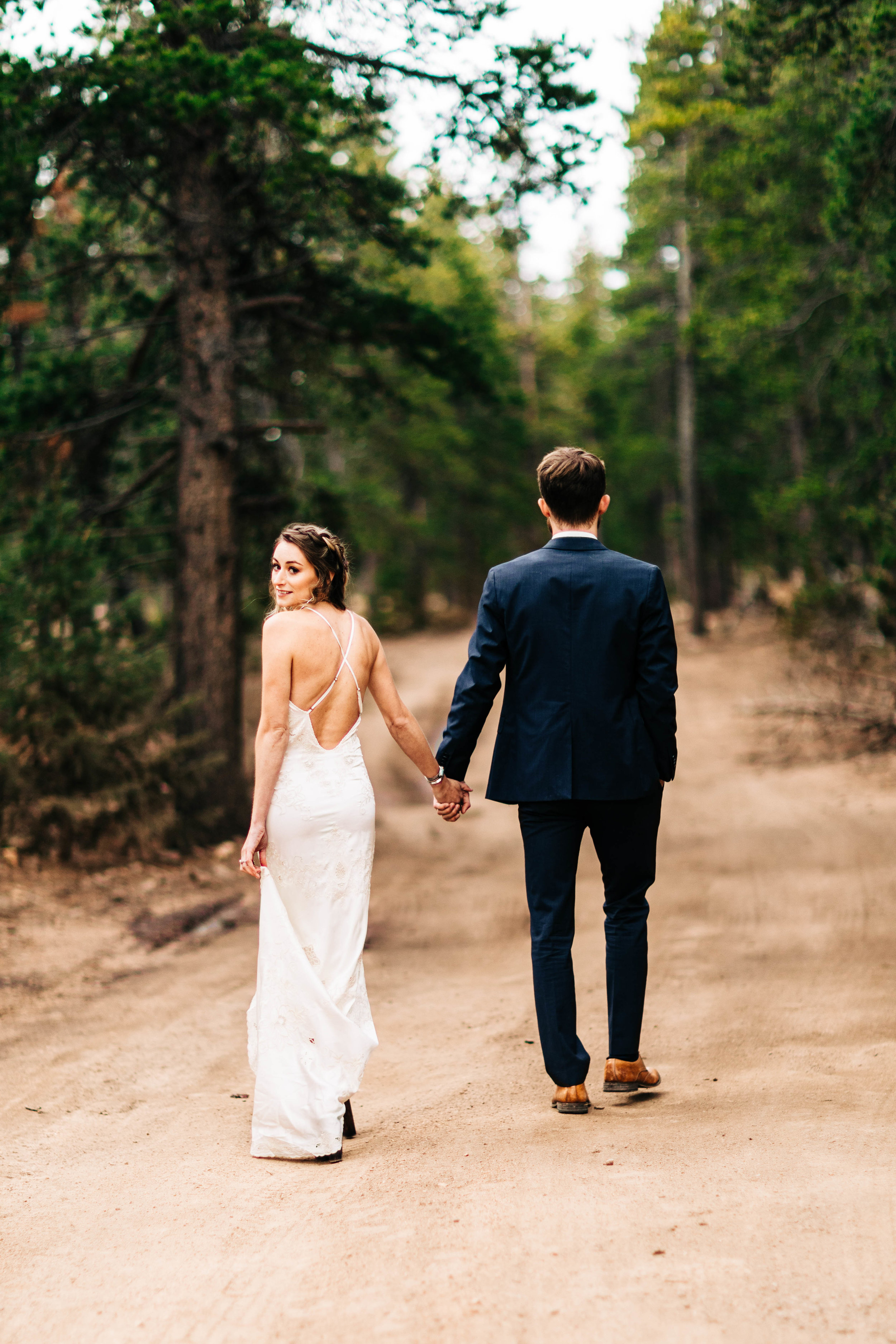 Colorado couple taking a stroll down a trail in the Rocky Mountains | elopement photographers