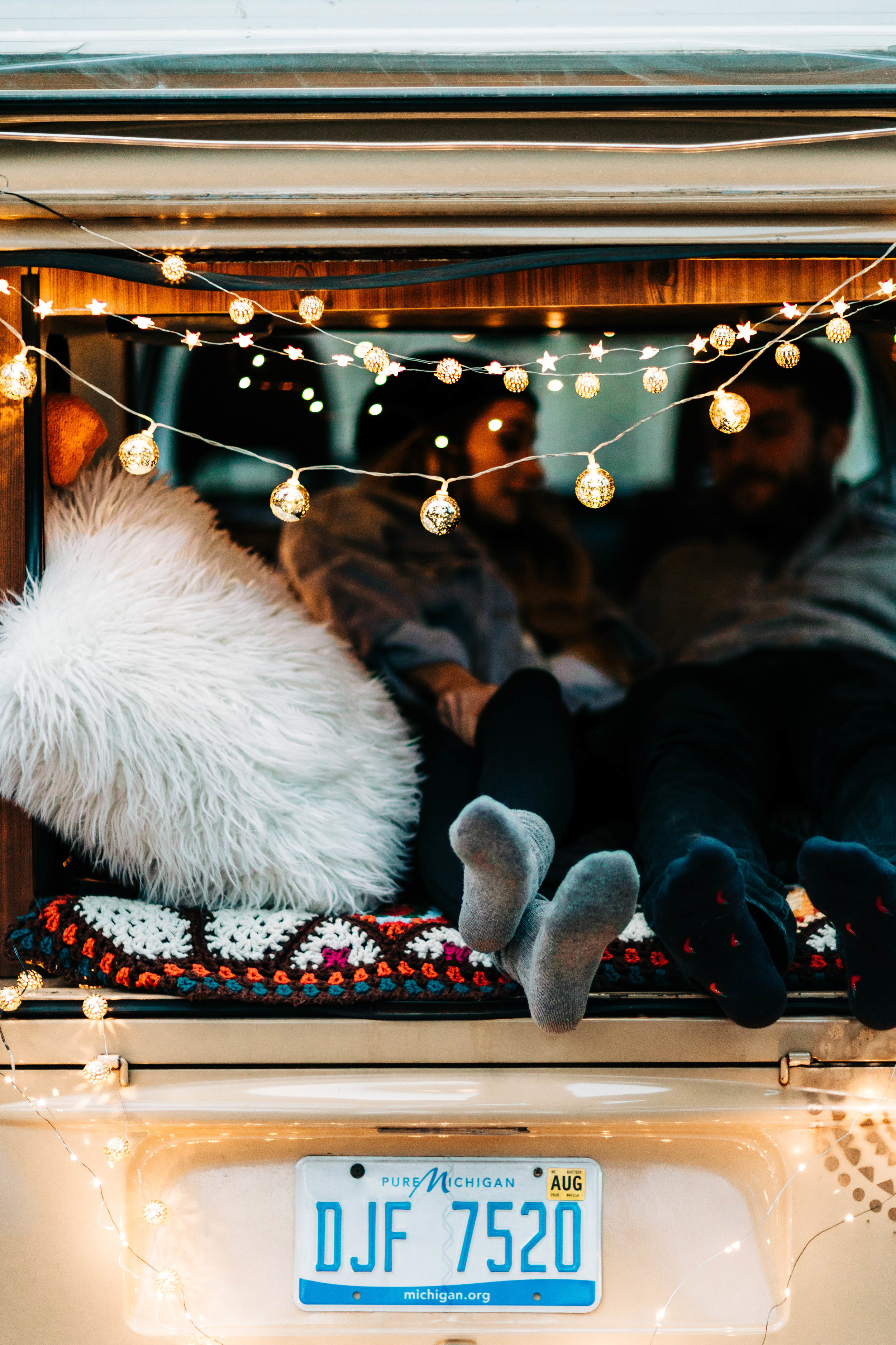 elopement photos inside a vintage camper van | van life elopement photographers