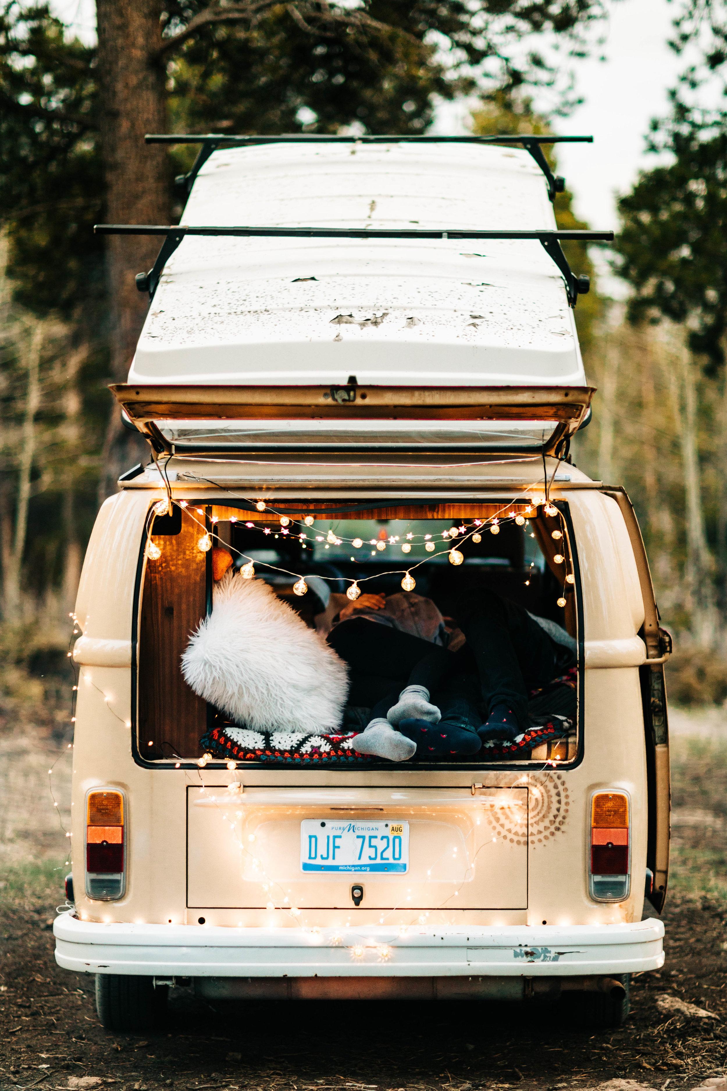 elopement photos inside a vintage camper van | traveling adventure elopement photographers