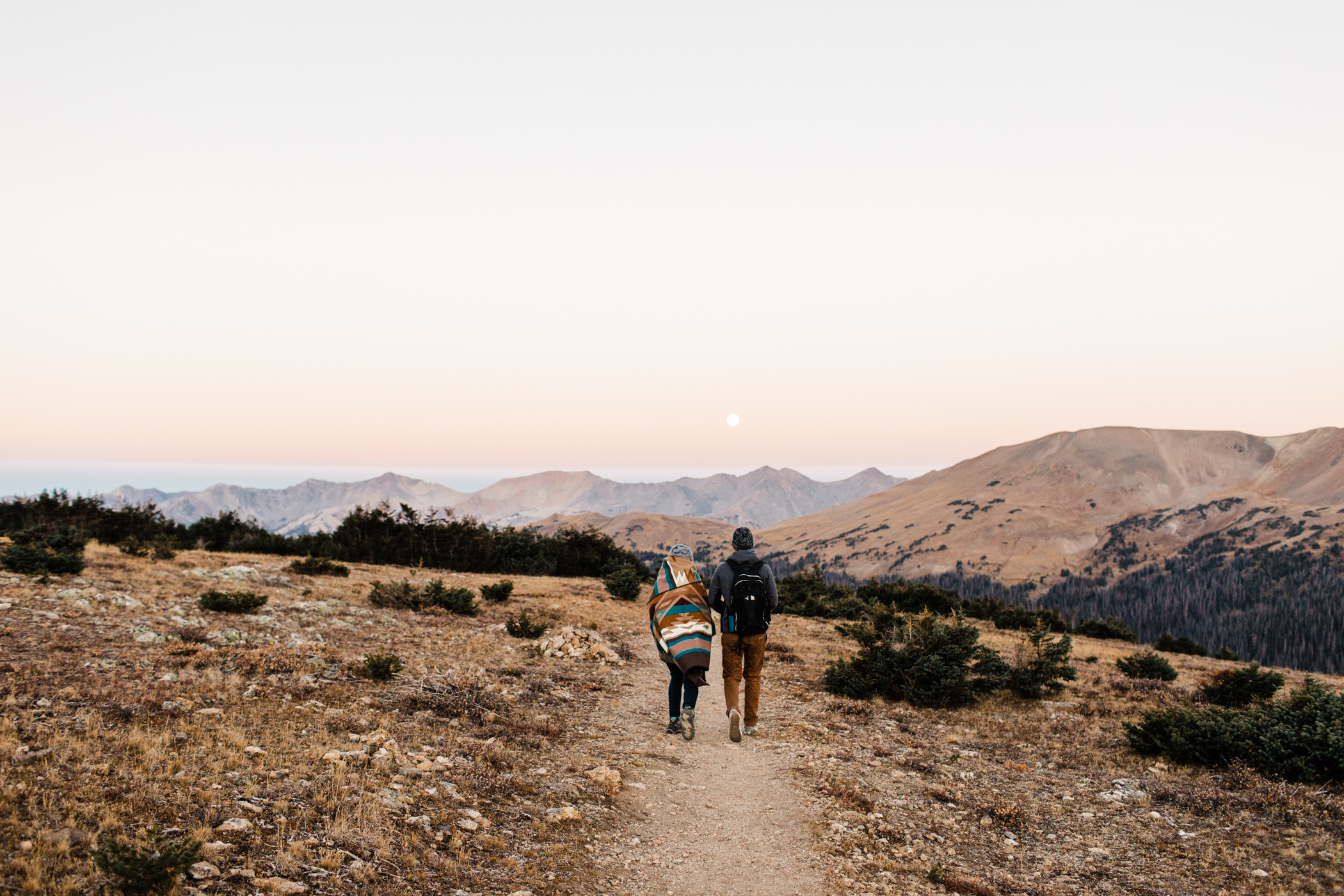 couple hiking during their Rocky Mountain engagement session | Mountain elopement photographers
