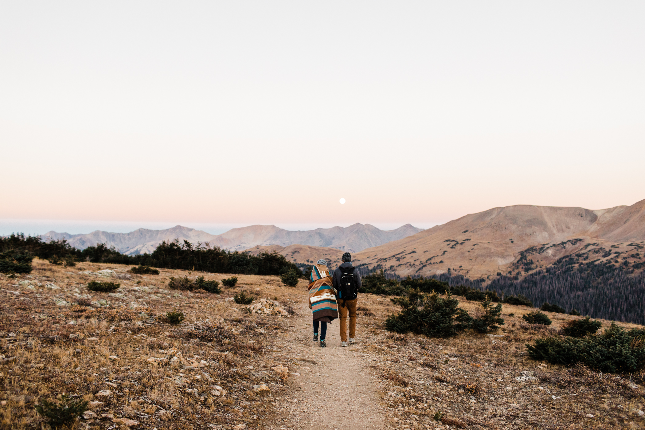 couple hiking during their Colorado Rocky Mountain National Park engagement photos | mountain elopement photographers based in Fort Collins