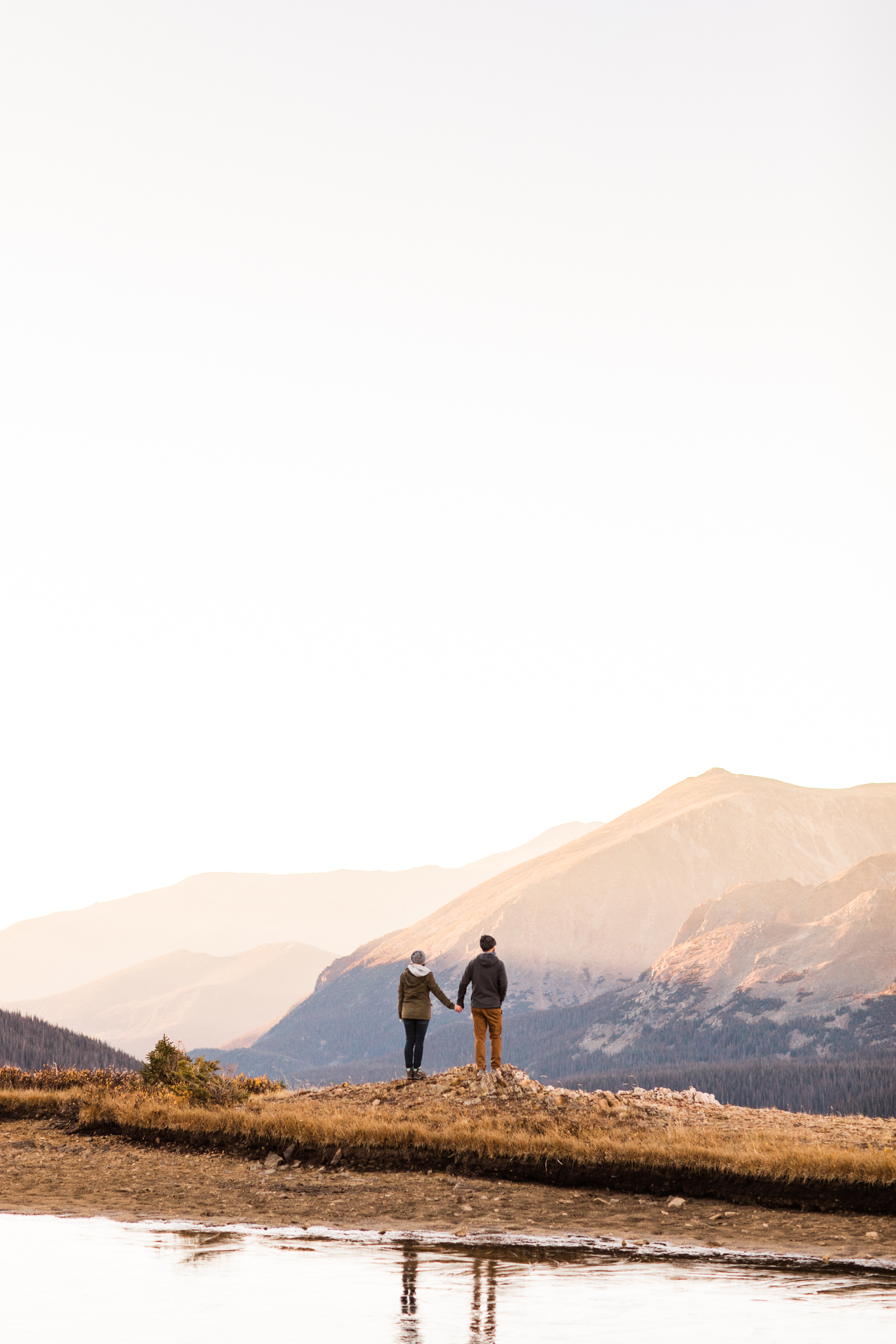 mountain engagement photos taken at an alpine lake in the Rocky Mountains | elopement photographers in Colorado