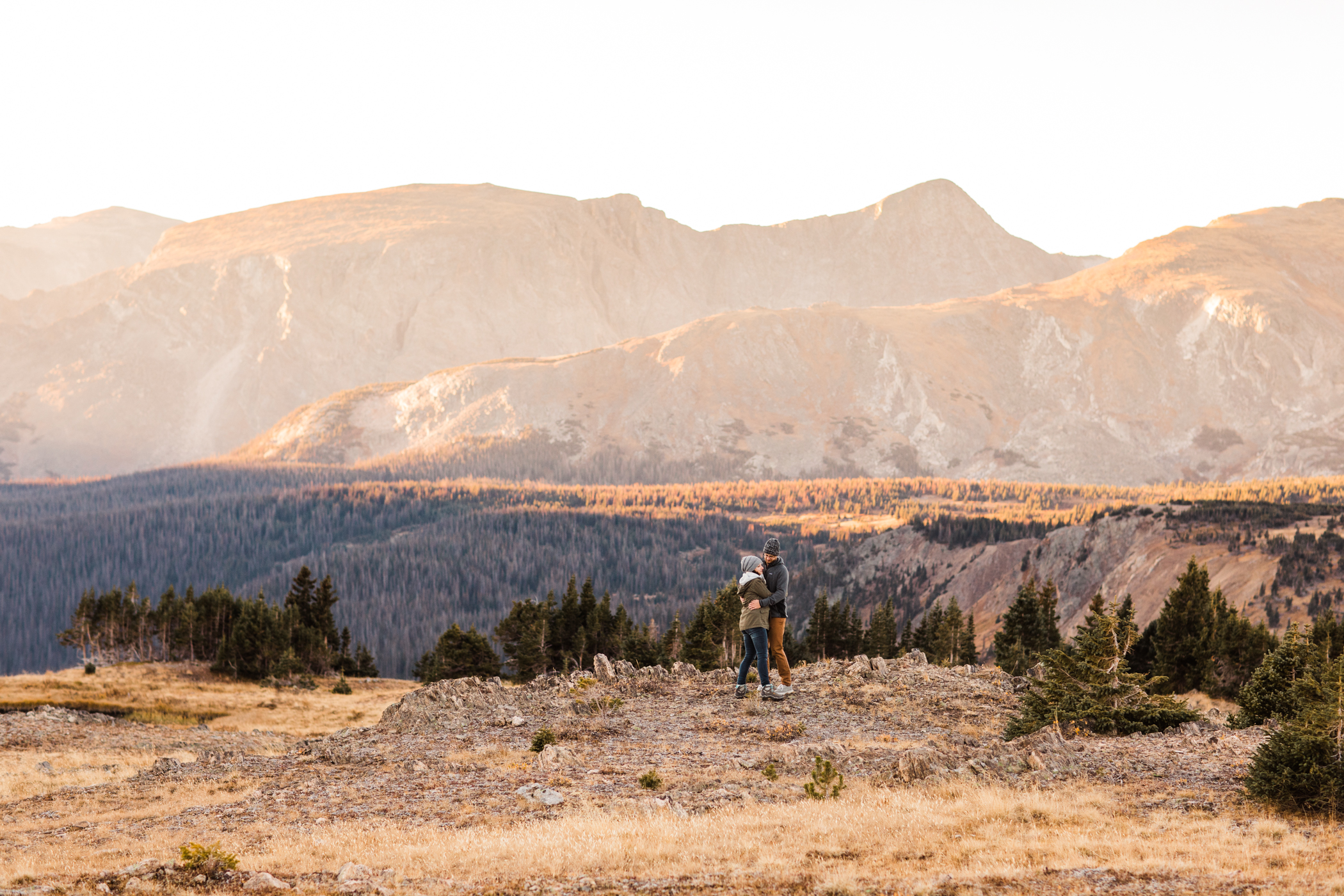 adventurous couple walking by an alpine lake in the Colorado mountains | adventure elopement photographers in the Rocky Mountains