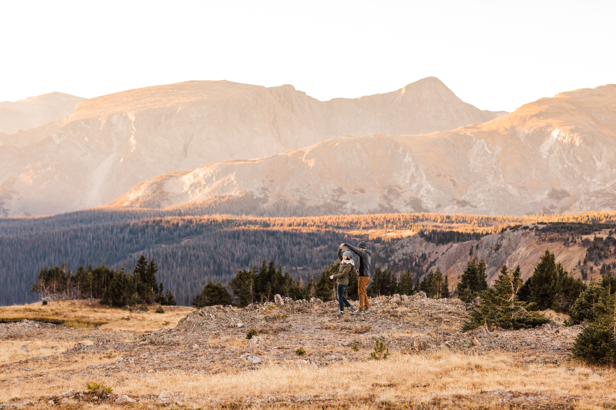 adventurous couple walking by an alpine lake in the Colorado mountains | Rocky Mountain National Park adventure elopement photographers