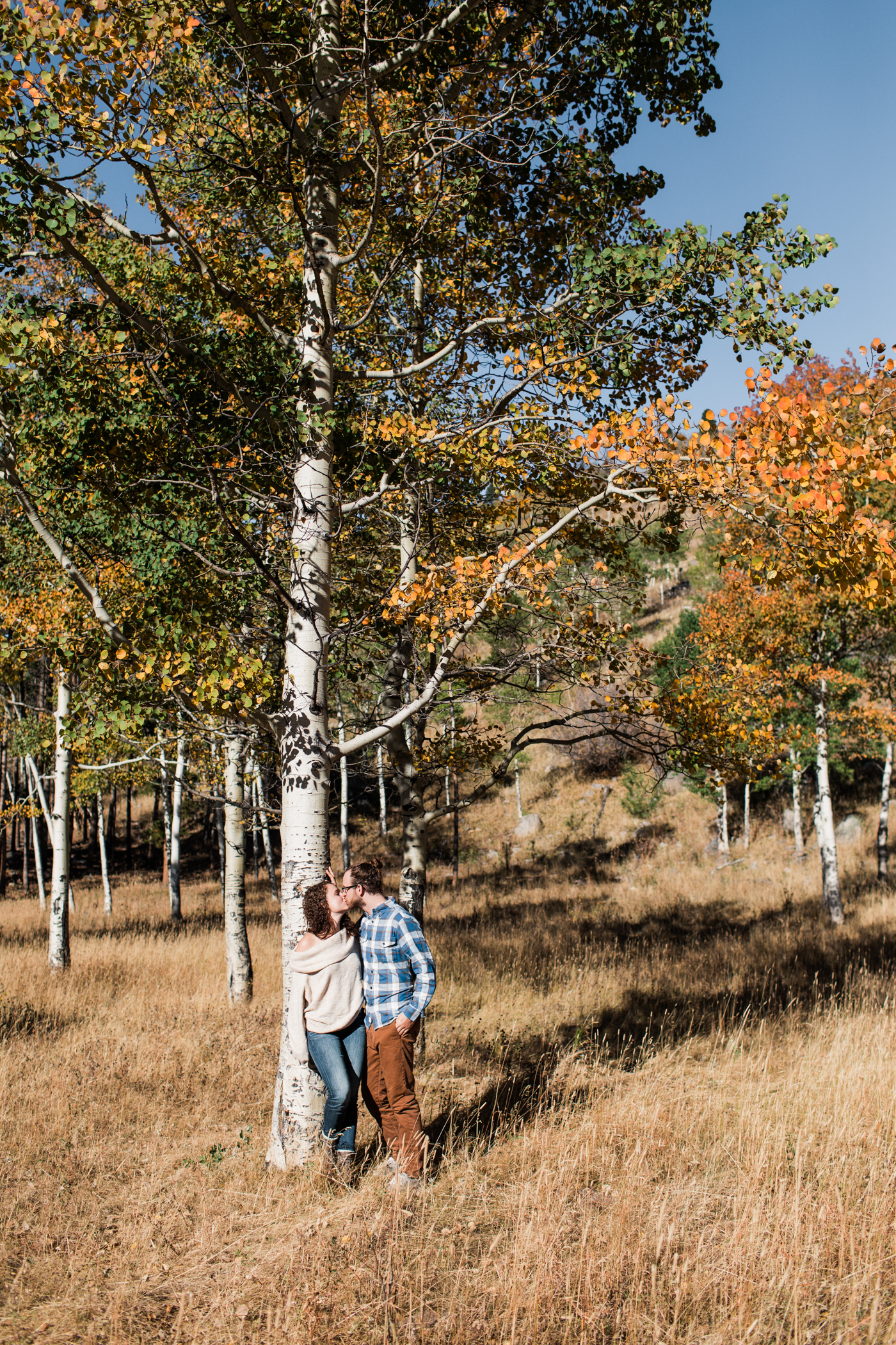 fall engagement photos under the Aspen trees in the mountains of Colorado | mountain adventure elopement photographers