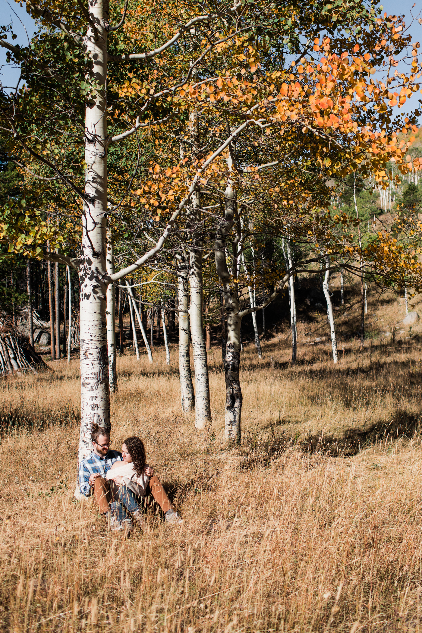 fall engagement photos under the Aspen trees in the mountains of Colorado | Rocky Mountain elopement photographers