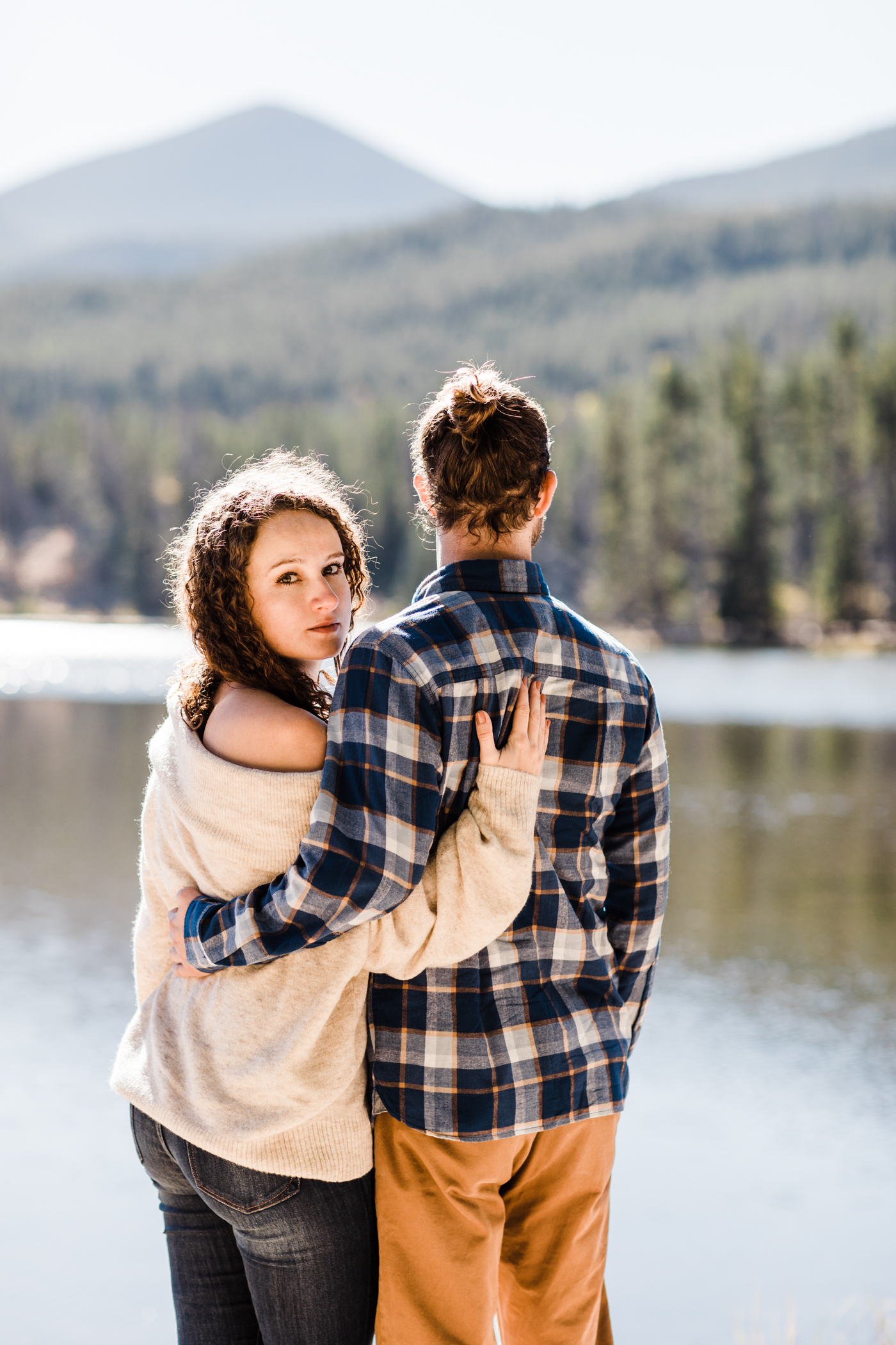engagement photos by a mountain lake in Colorado | Rocky Mountain elopement photographers