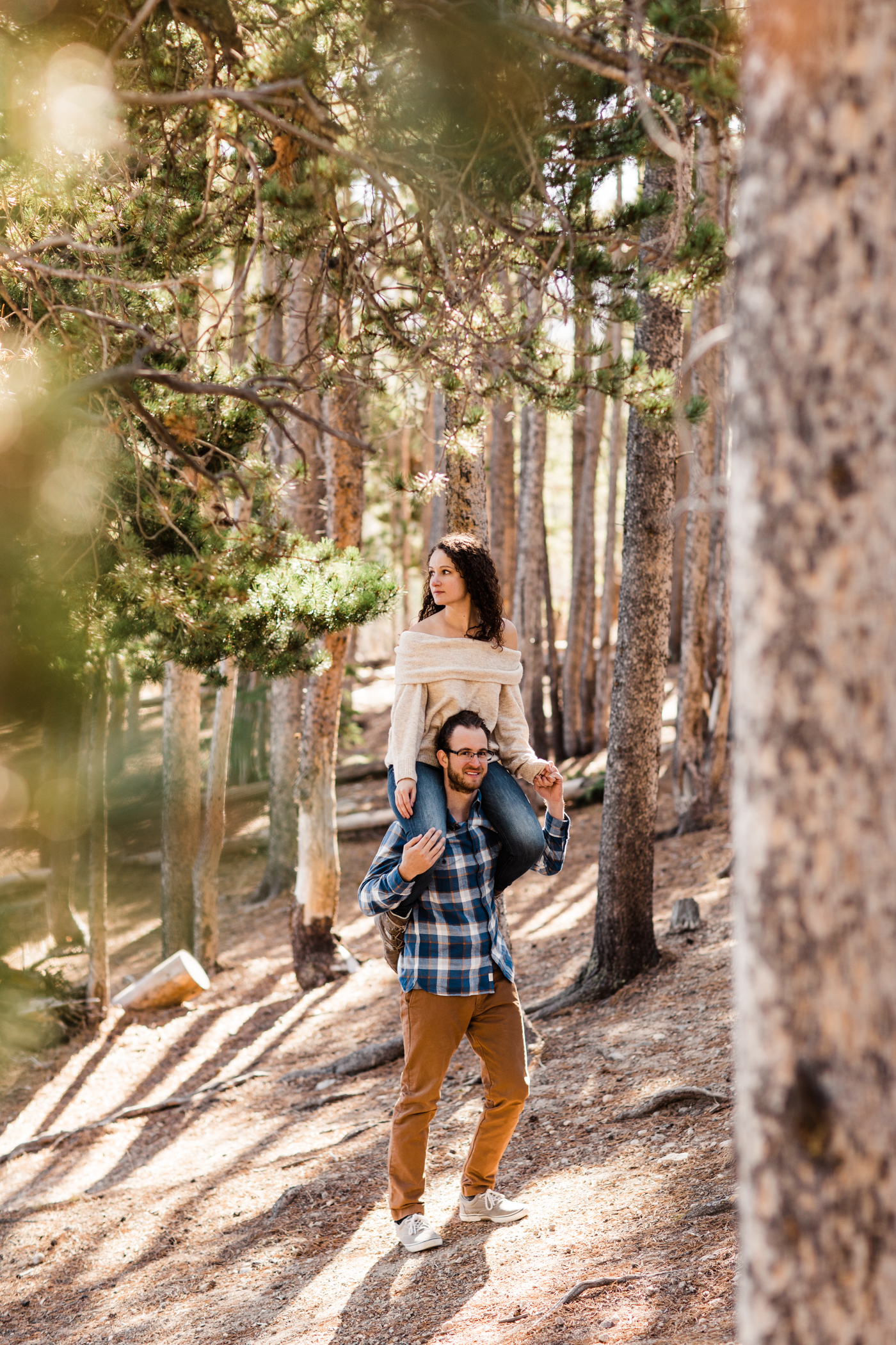playful engagement session with an adventurous couple near Sprague Lake | Rocky Mountain National Park elopement photographers