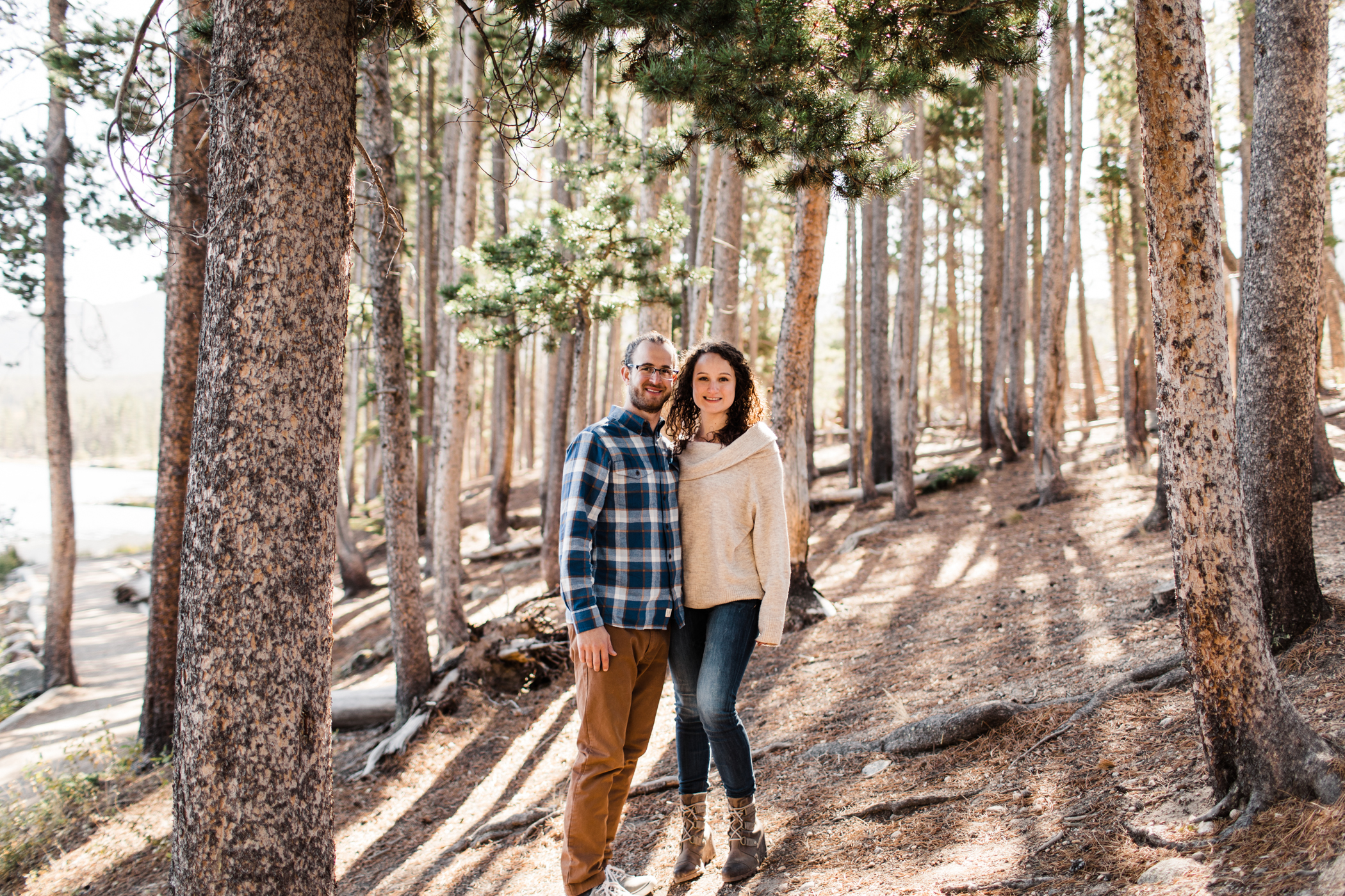 couple smiling at the camera during their mountain engagement session in the Rocky Mountains | Colorado mountain elopement photographers