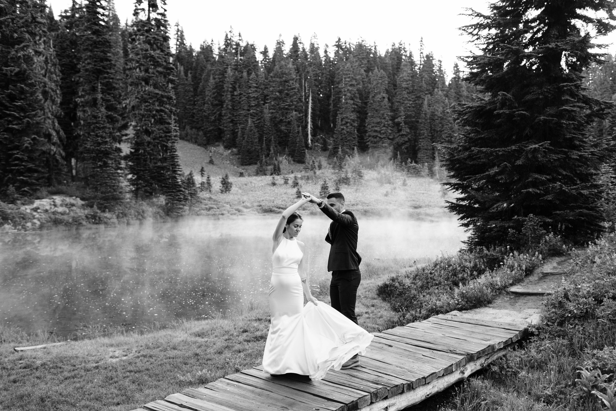eloping couple dancing by an alpine lake during their Mount Rainier National Park elopement | Washington state adventure wedding photographers