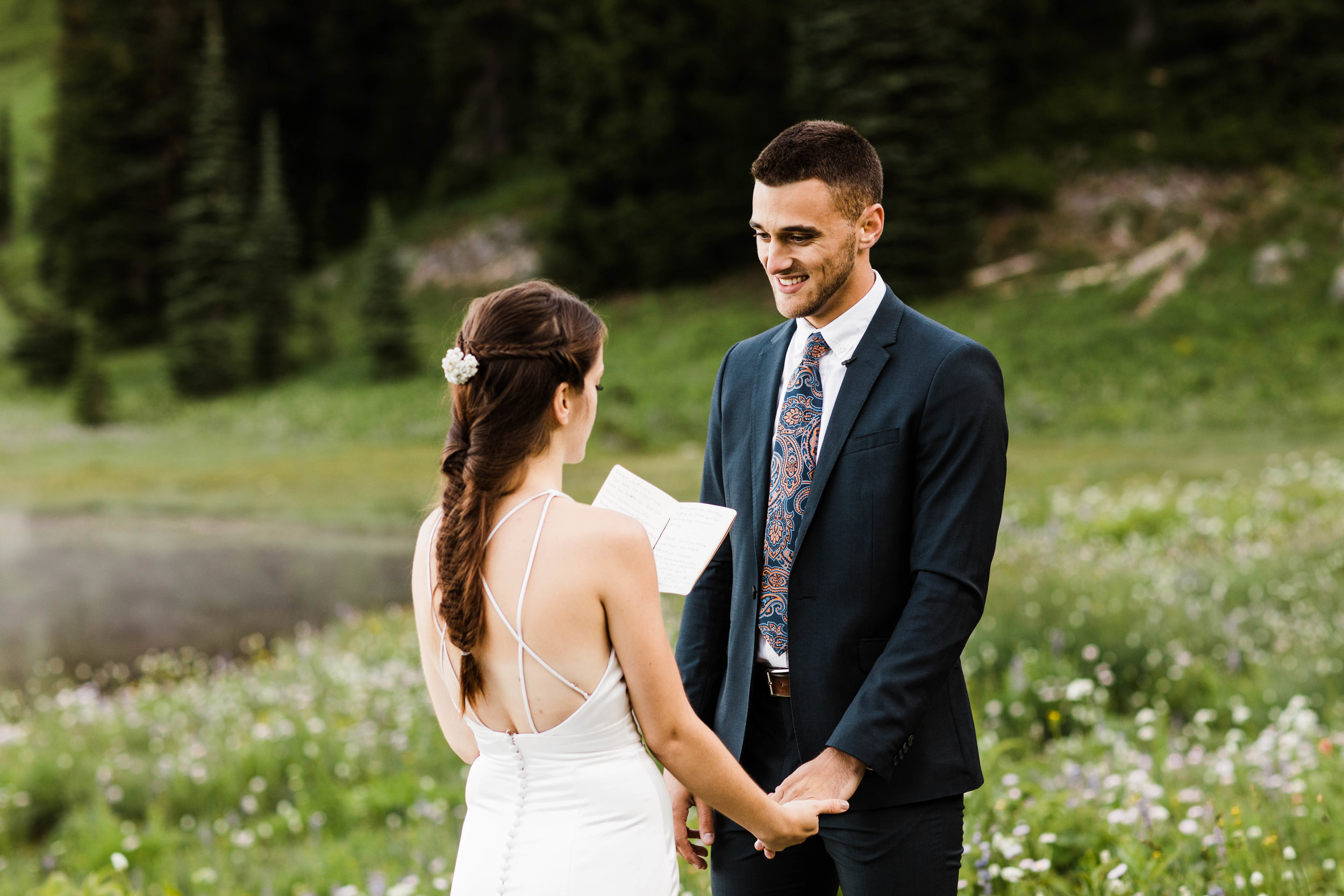 bride reading vows during Mount Rainier elopement ceremony in the mountains | Washington national park adventure wedding