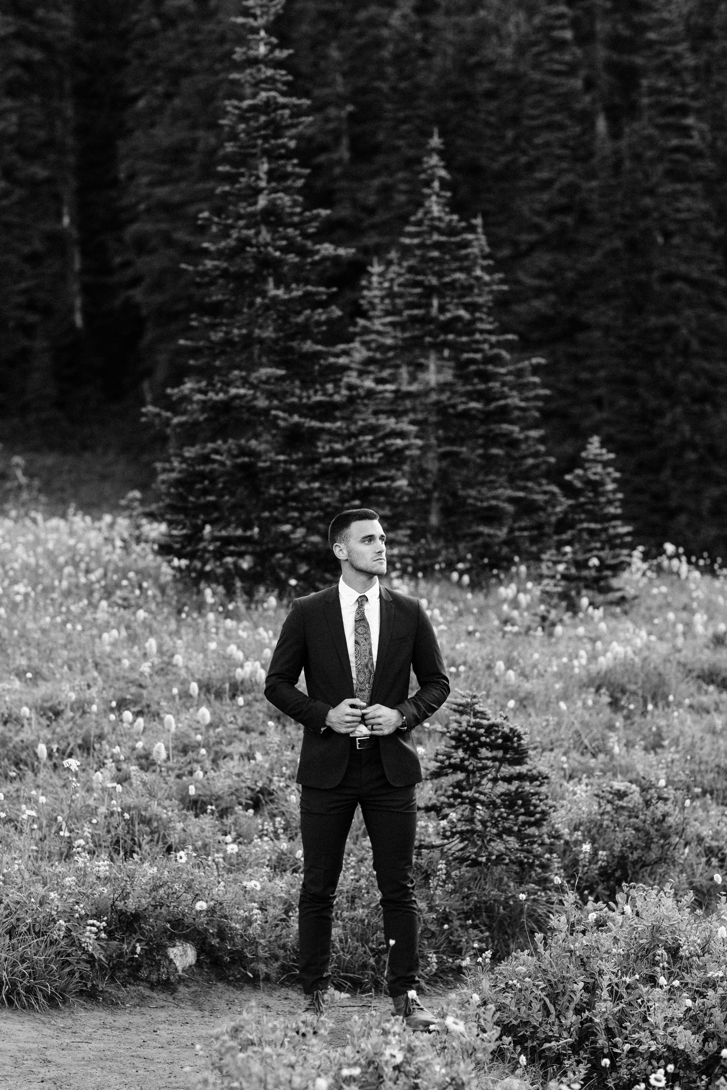 groom photos during an adventurous national park elopement in Mount Rainier | Washington state elopement and adventure wedding photographers