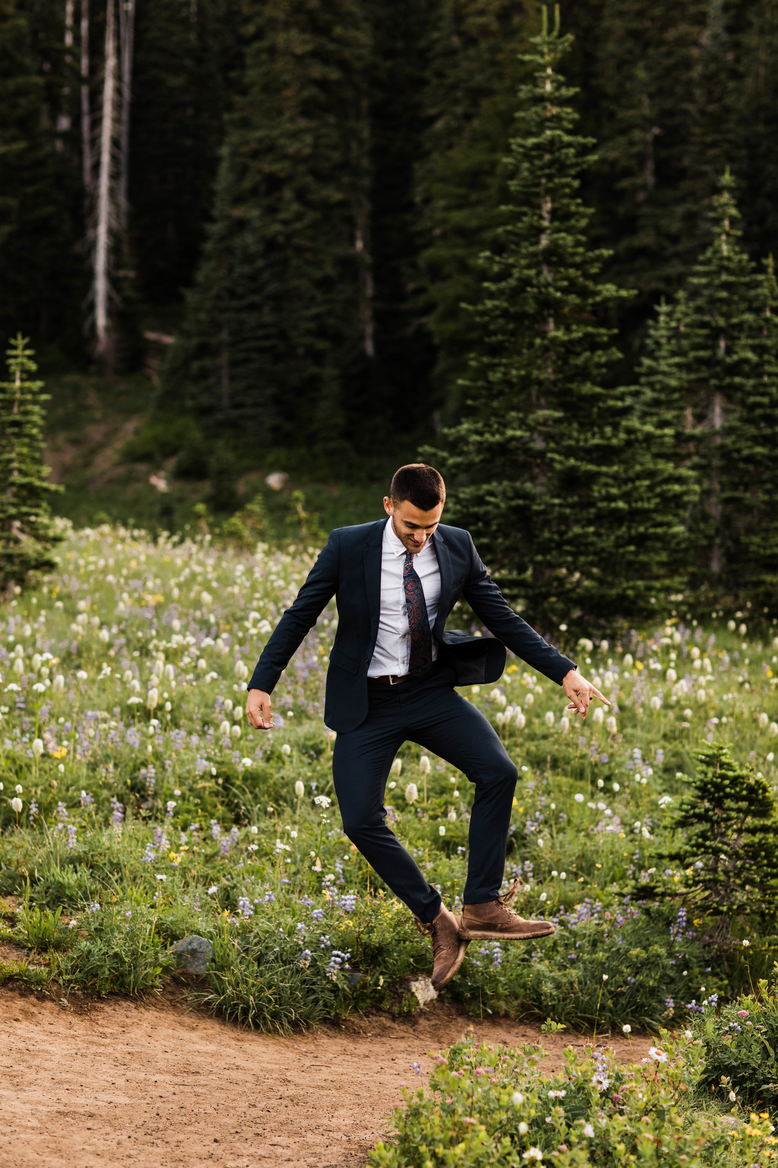 groom photos during an adventurous national park elopement in Mount Rainier | Seattle Washington elopement and adventure wedding photographers
