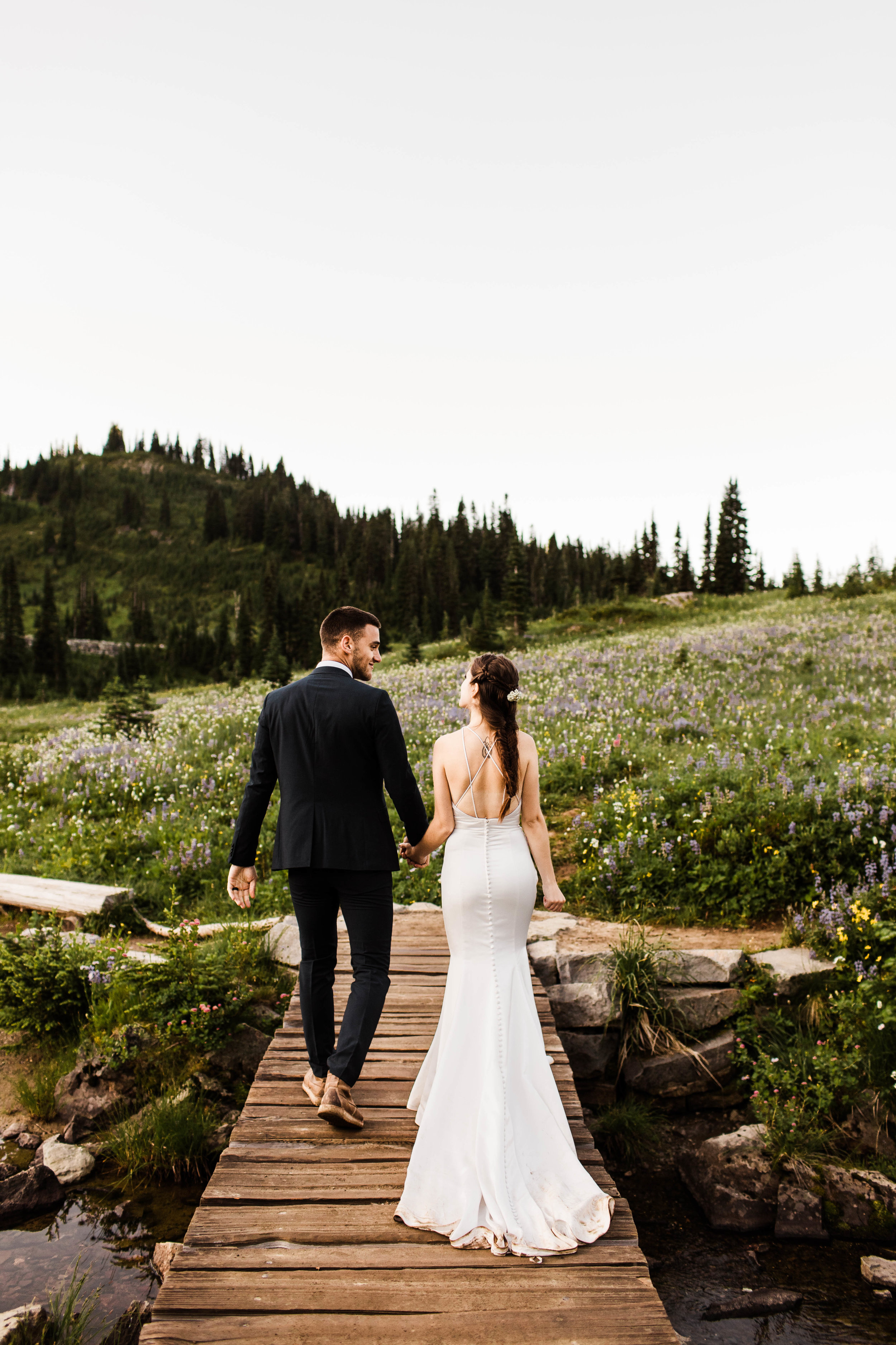 couples elopement photos during an adventurous national park elopement in Mount Rainier | Washington state elopement and adventure wedding photographers