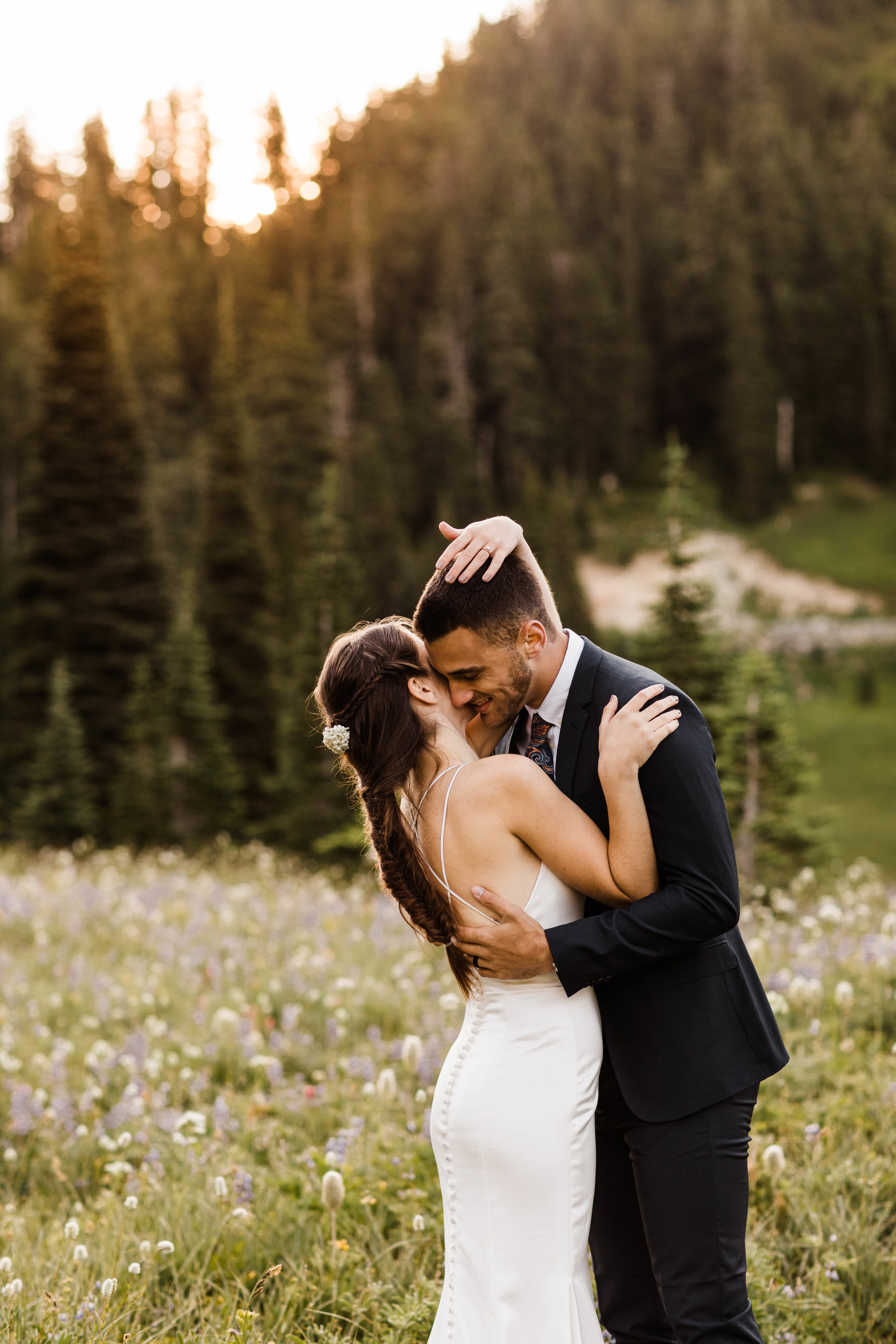couple giggling during their Mount Rainier National Park elopement in Washington state | Seattle adventure wedding and elopement photographers