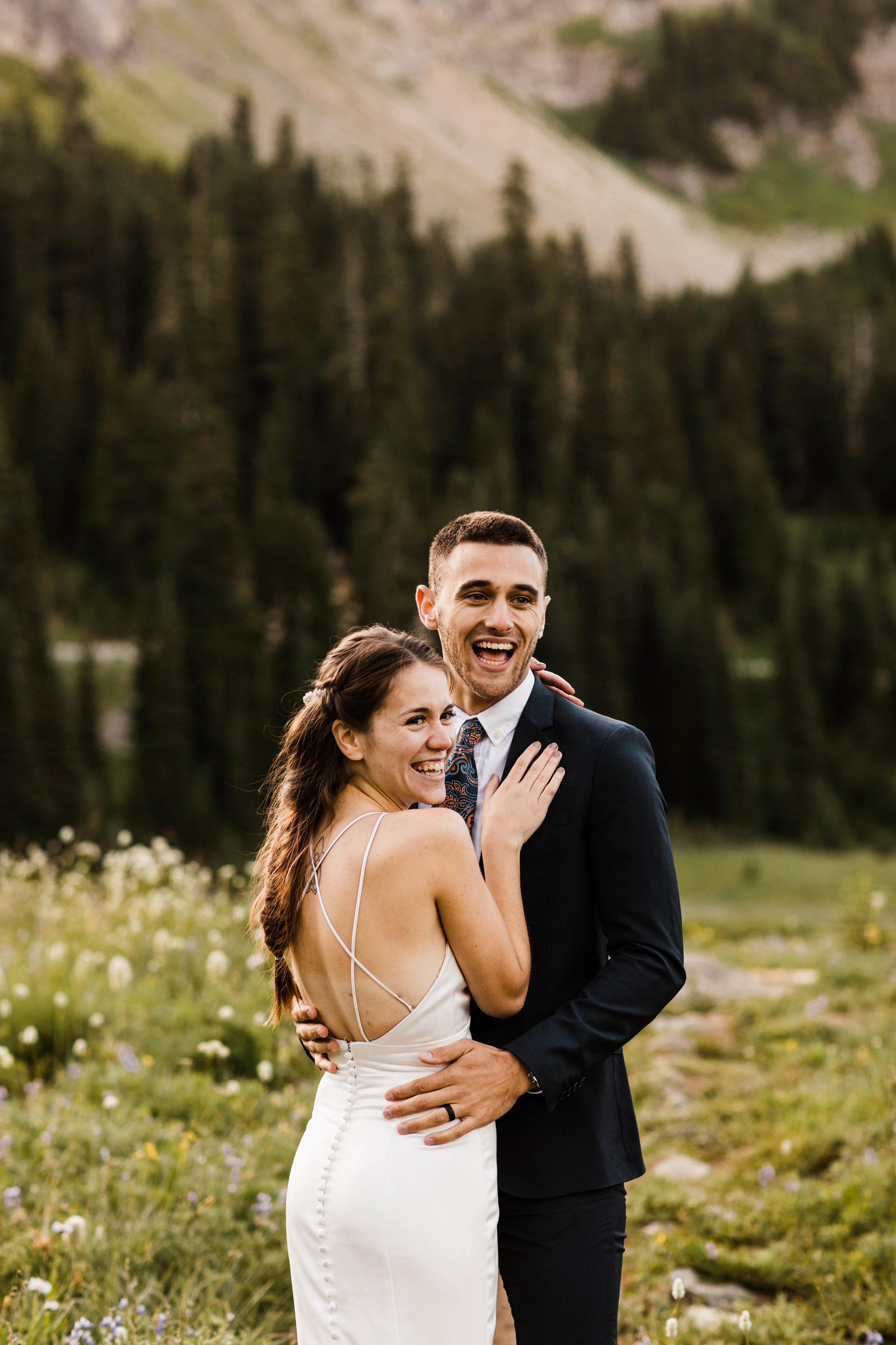 couple giggling during their Mount Rainier National Park elopement in Washington state | Seattle adventure elopement photographers