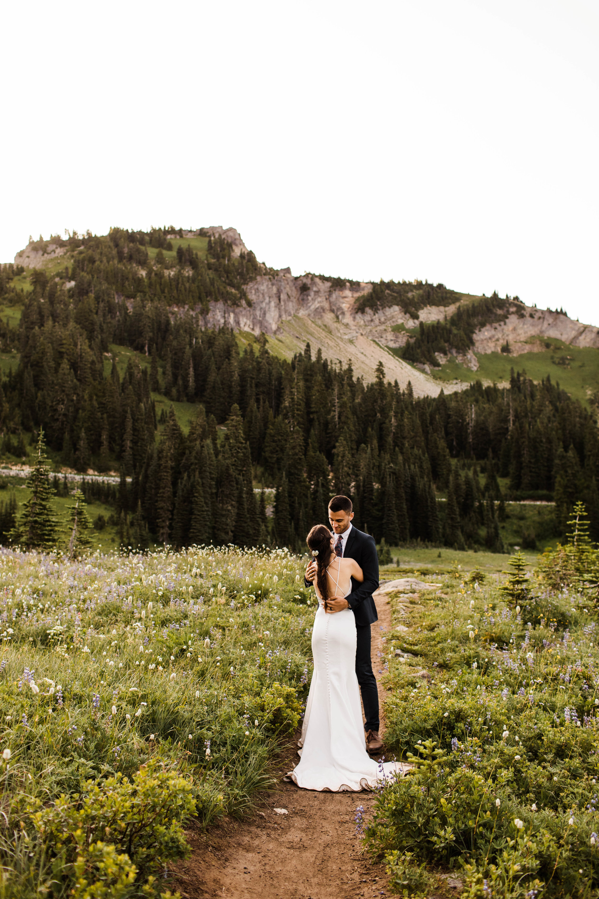 couple giggling during their Mount Rainier National Park elopement in Washington state | Seattle elopement and adventure wedding photographers