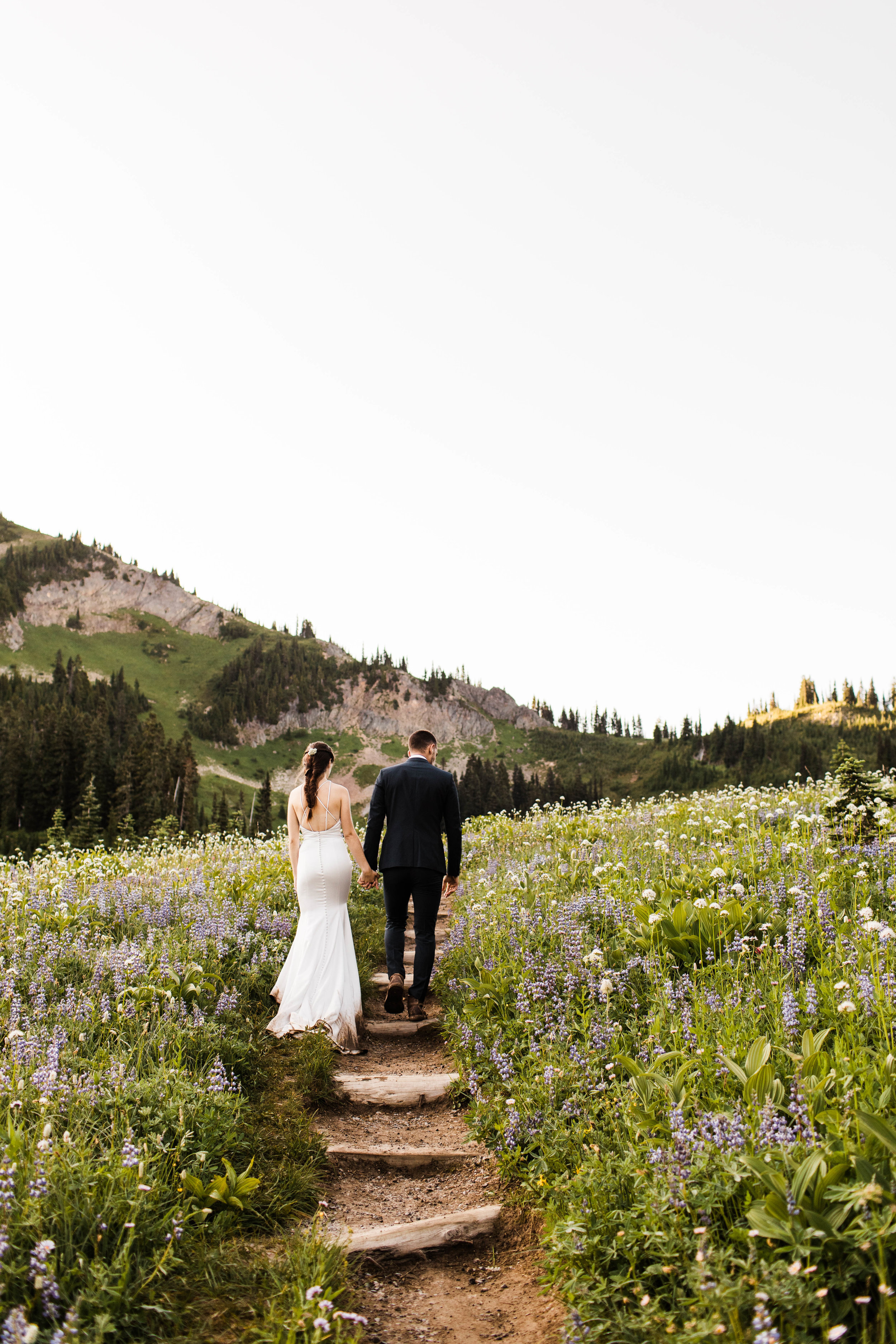 couple hiking for their Mt Rainier National Park elopement | Seattle elopement and adventure wedding photographers