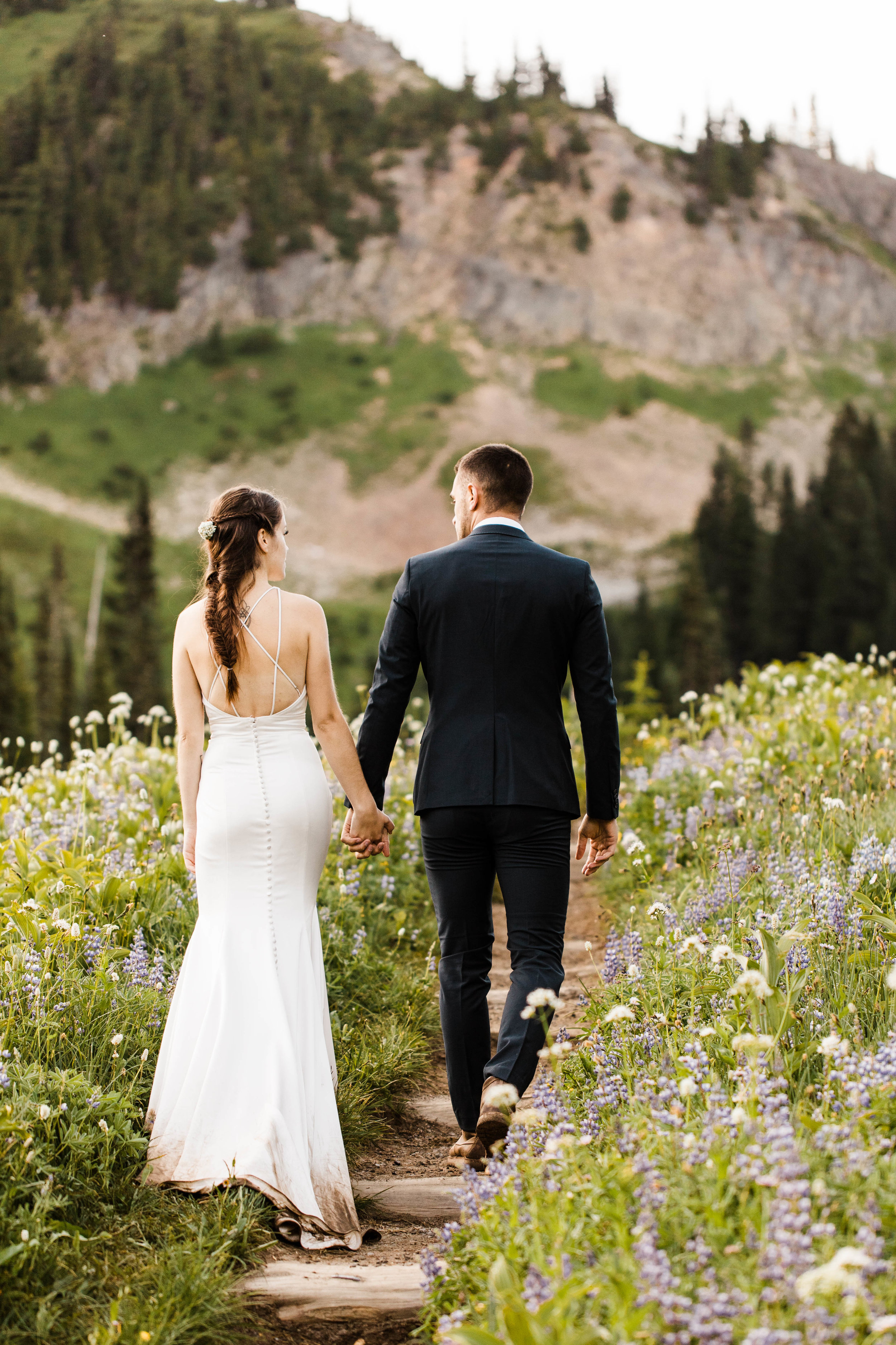 couple hiking for their Mt Rainier National Park elopement | elopement and adventure wedding photographers in Seattle Washington