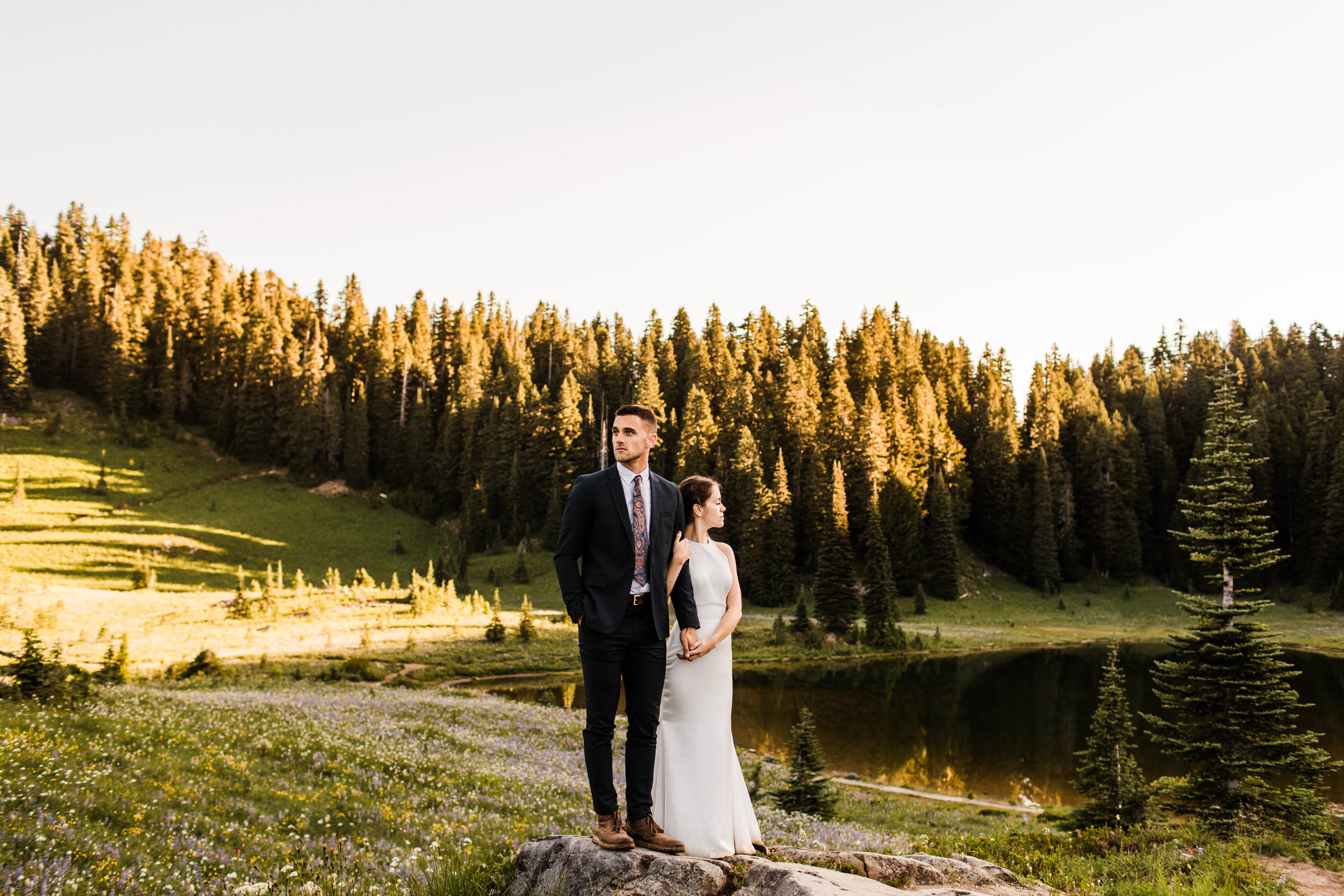 eloping couple watching the sun rise during their Mt Rainier National Park elopement | adventure wedding and elopement photographers near Seattle WA