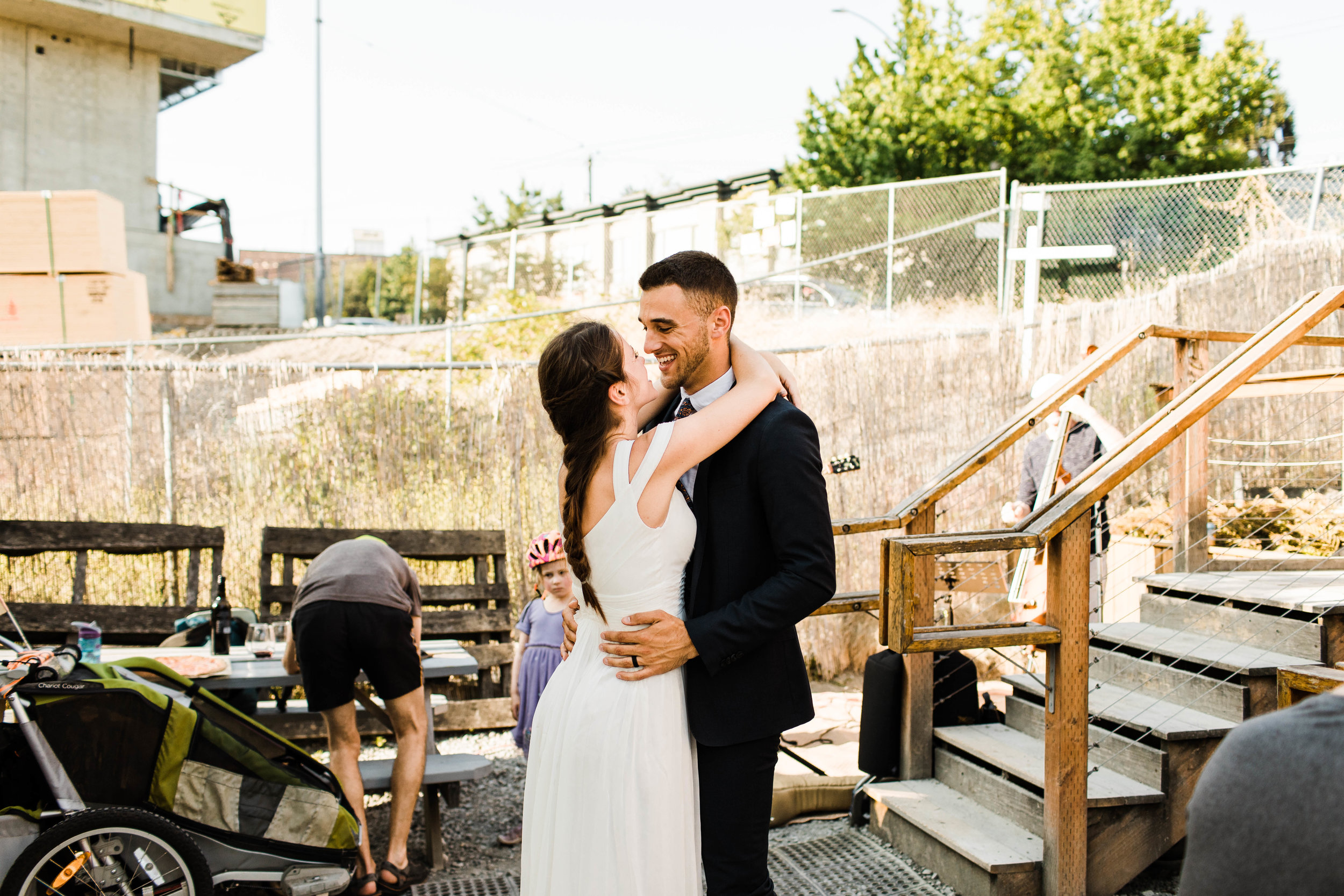 couple dancing at pizza restaurant Humble Pie in Seattle Washington after their Mt Rainier National Park elopement