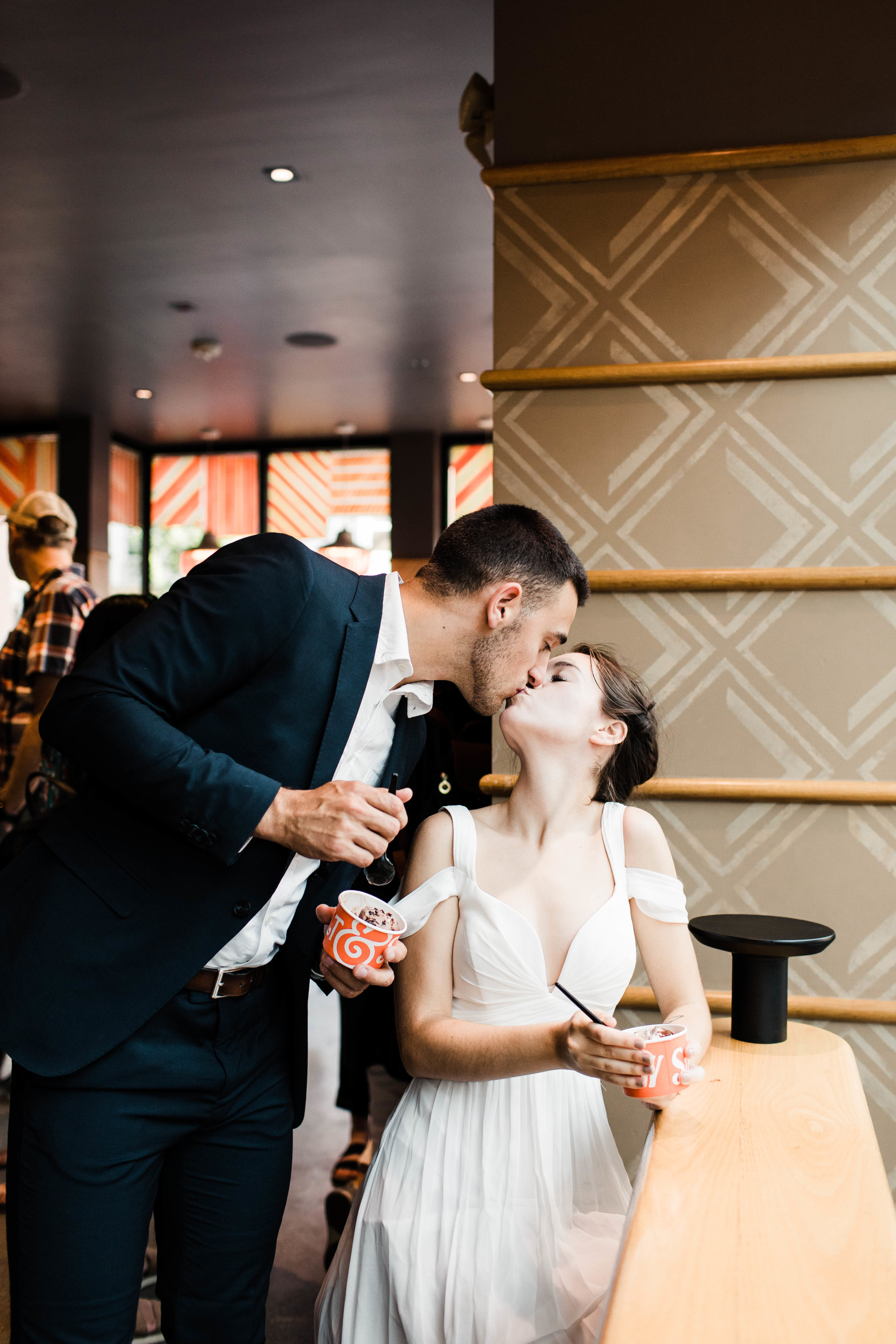 couple eating ice cream at Salt and Straw in Seattle Washington after their Mt Rainier elopement | national park elopement photographers