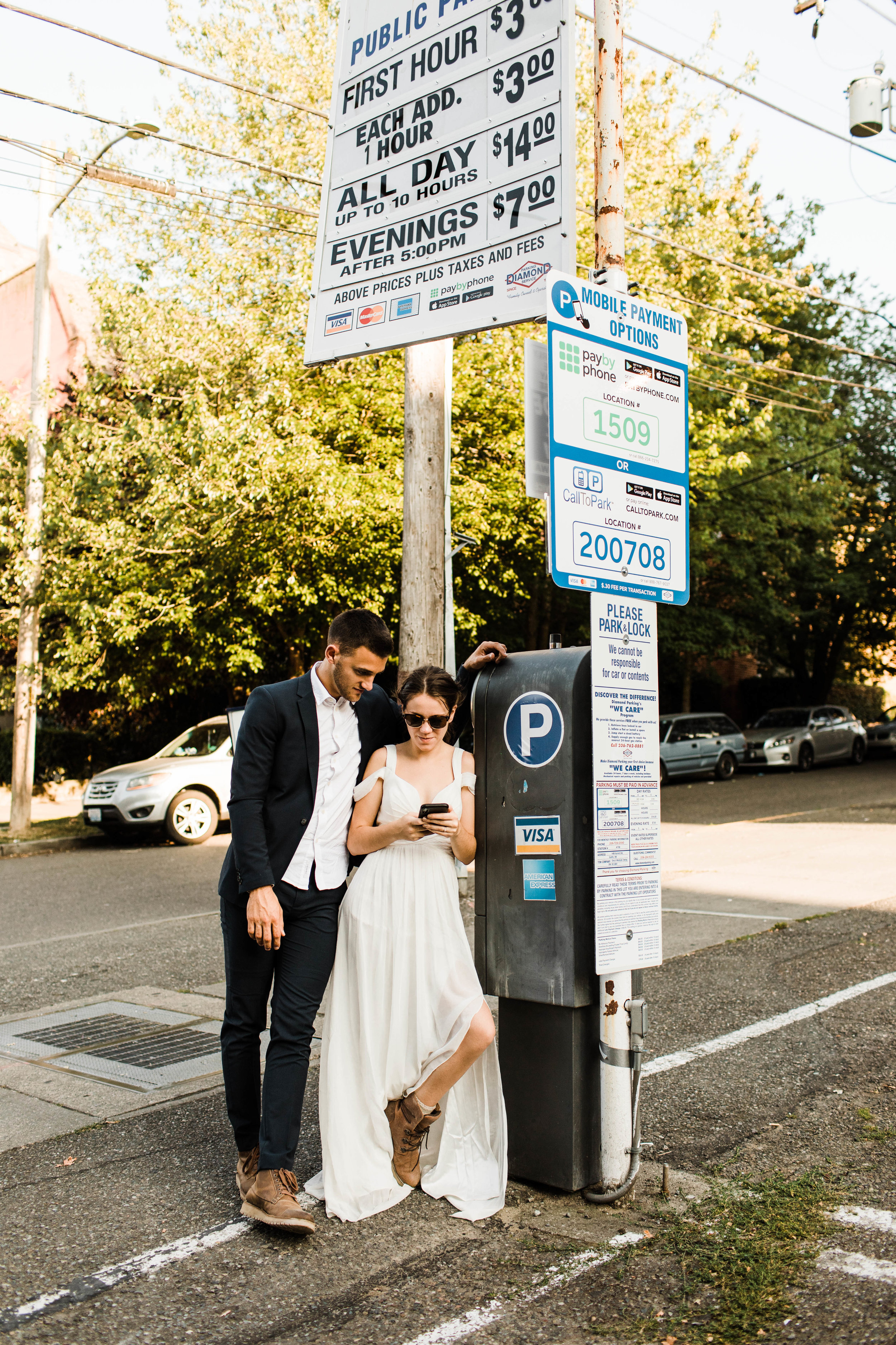 couple wandering through Seattle Washington after their Mt Rainier elopement | national park elopement and adventure wedding photographers
