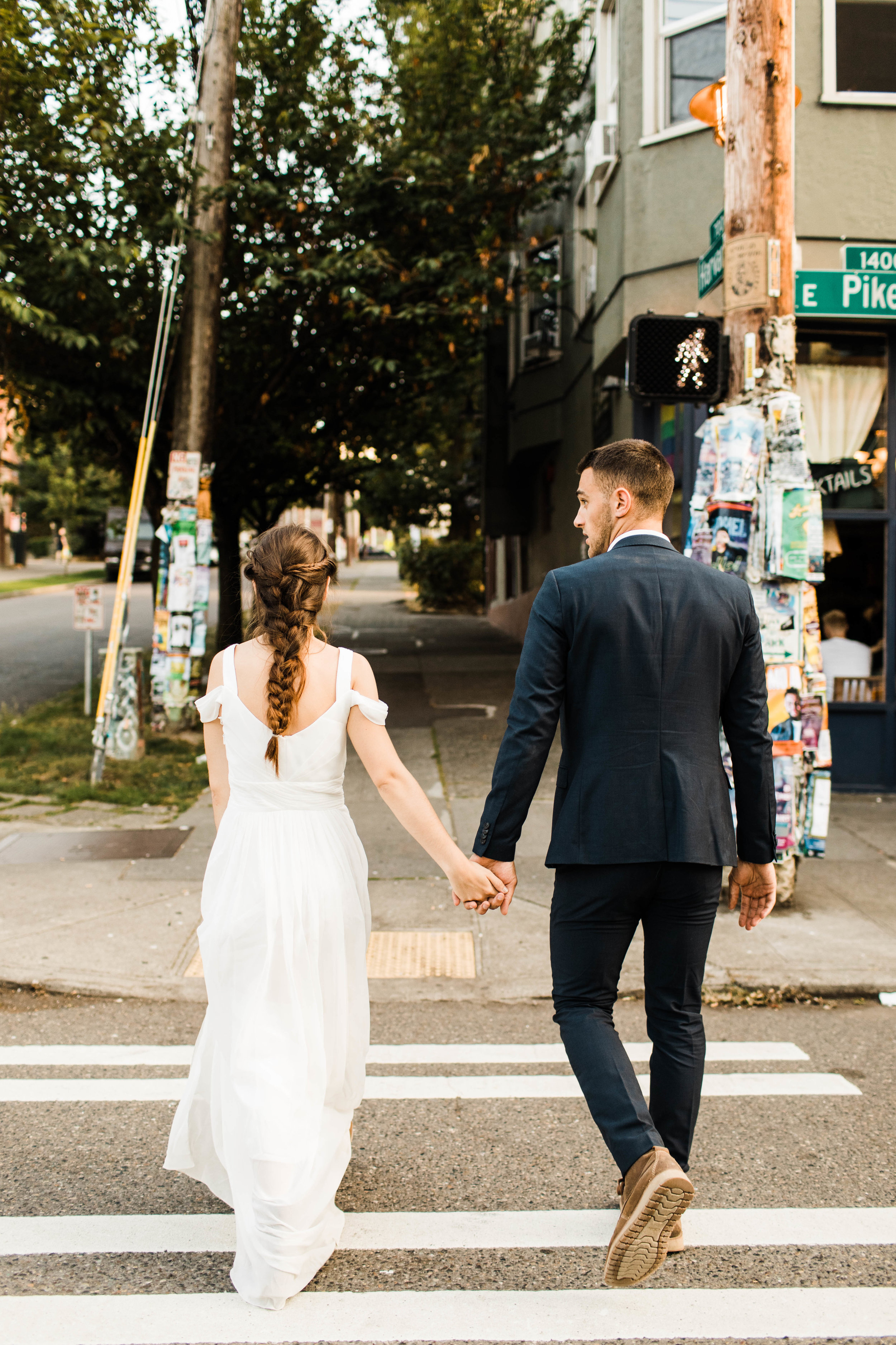 couple wandering through Seattle Washington after their Mt Rainier elopement | national park wedding photographers