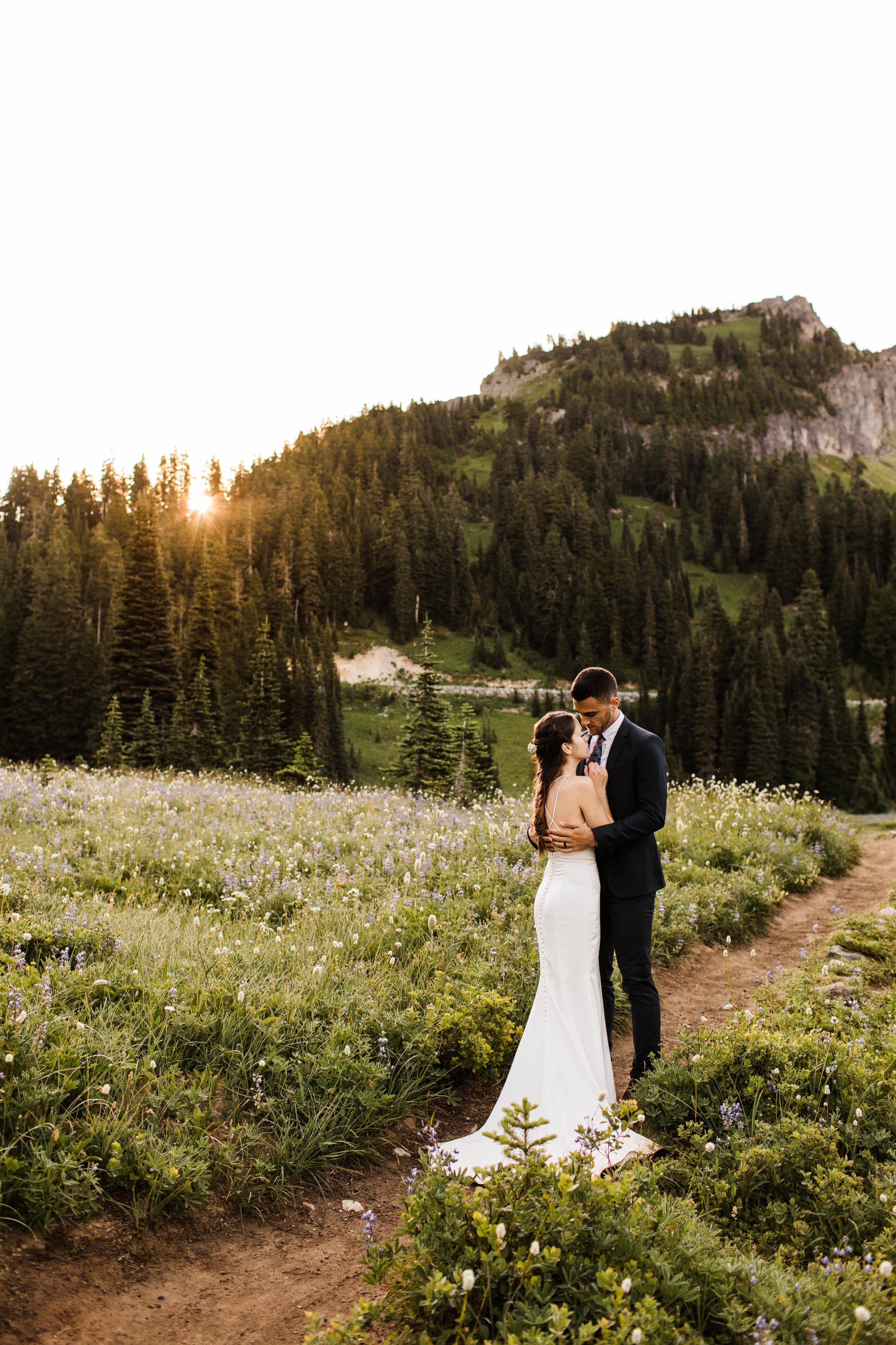 Couple eloping by a lake in Mount Rainier National Park in Washington state | Washington elopement photographers
